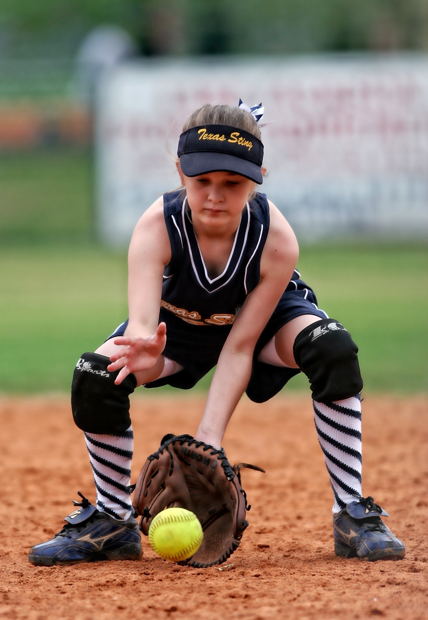 Softball player about to catch the ball photo