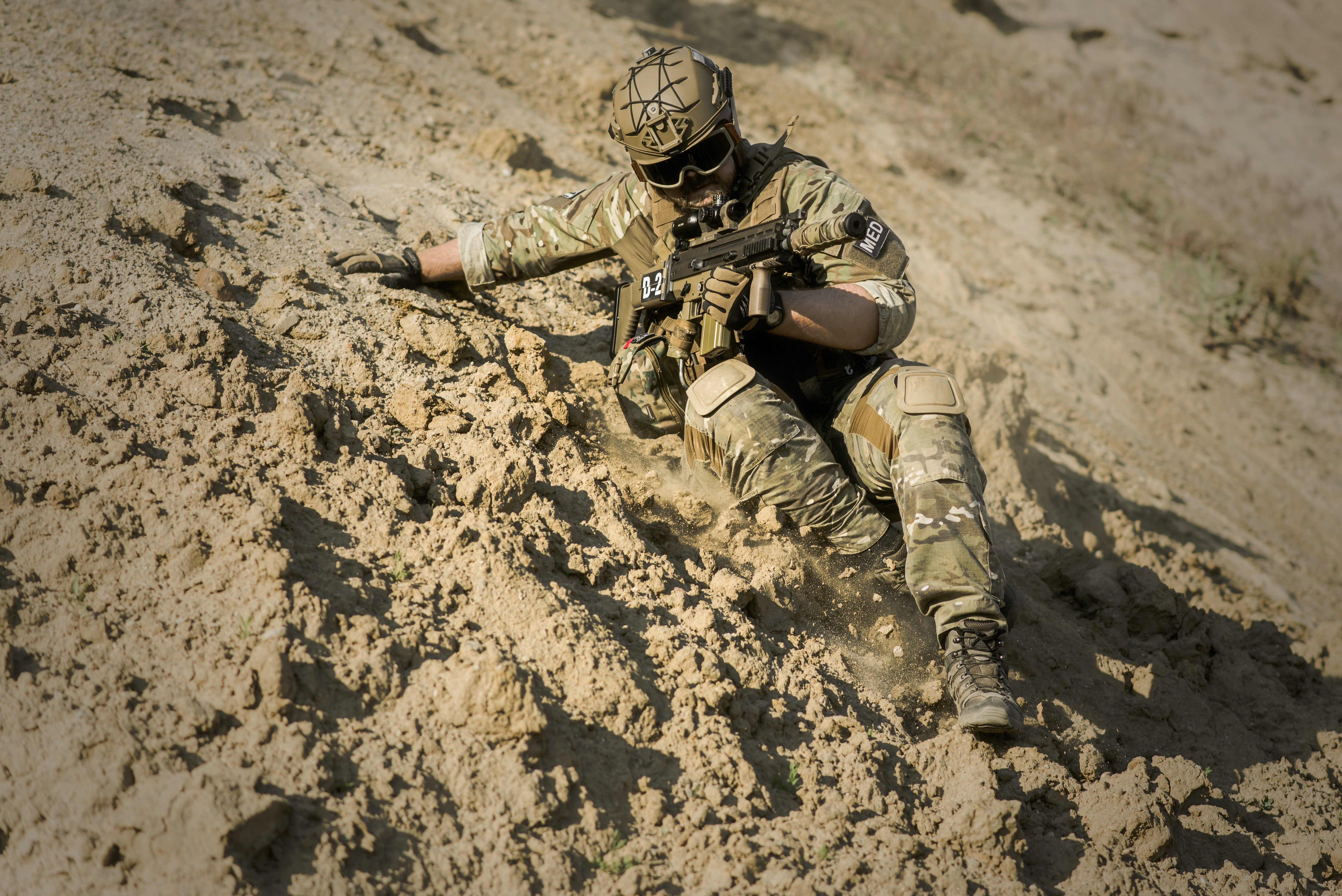 Soldier Sliding Downhill Holding Rifle during Daytime, Action, Adventure, Army, Camouflage, HQ Photo
