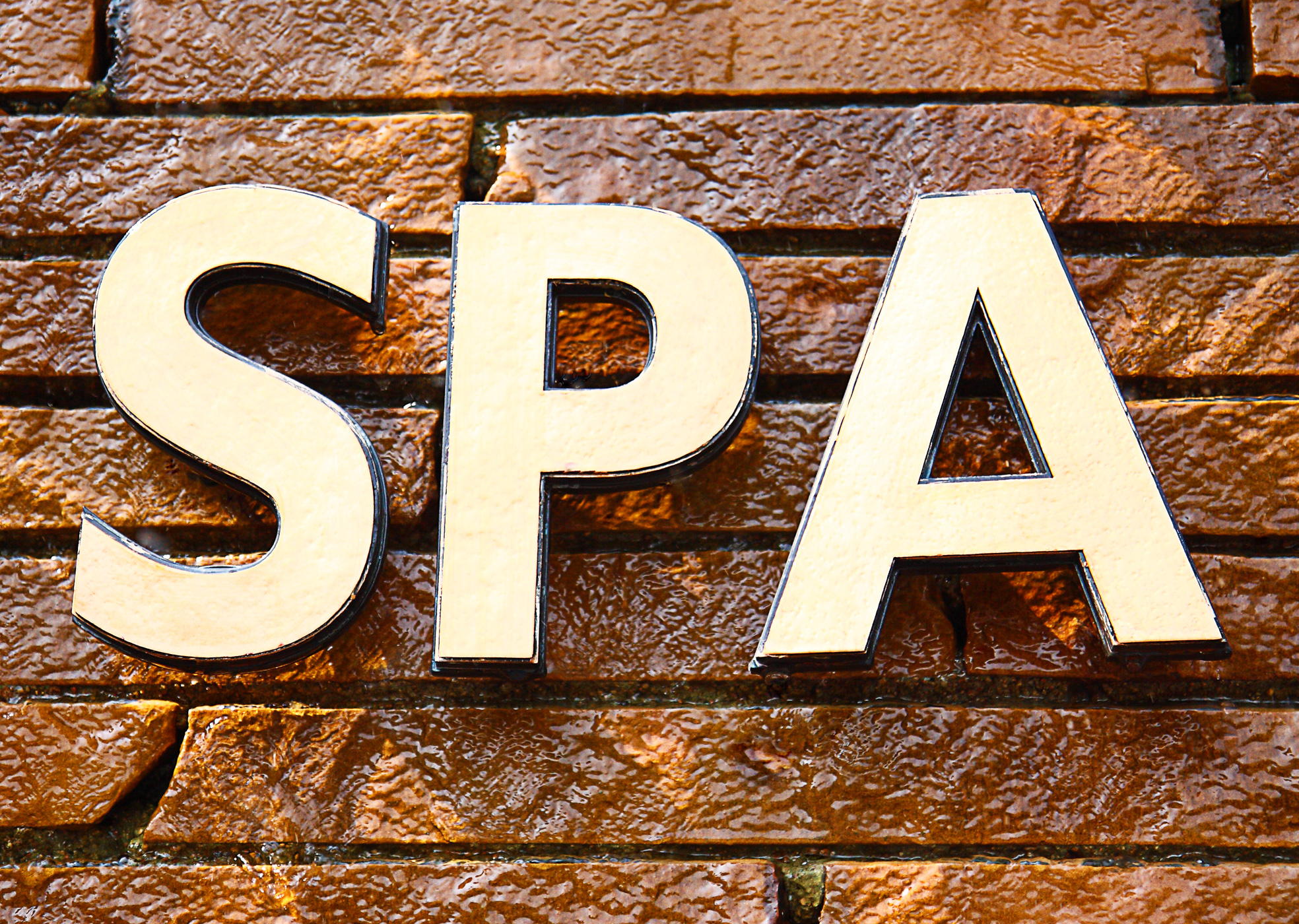 Spa sign on the wall - massage photo