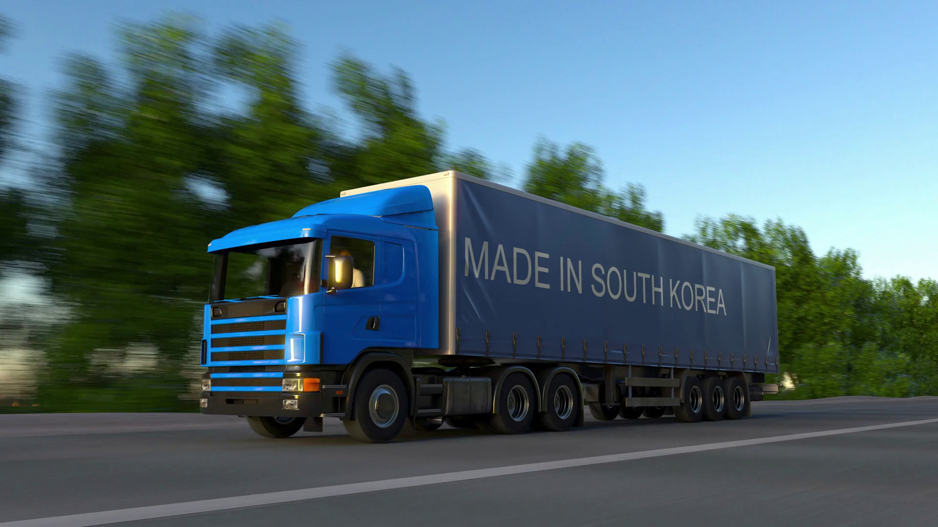 Speeding freight semi truck with MADE IN SOUTH KOREA caption on the ...