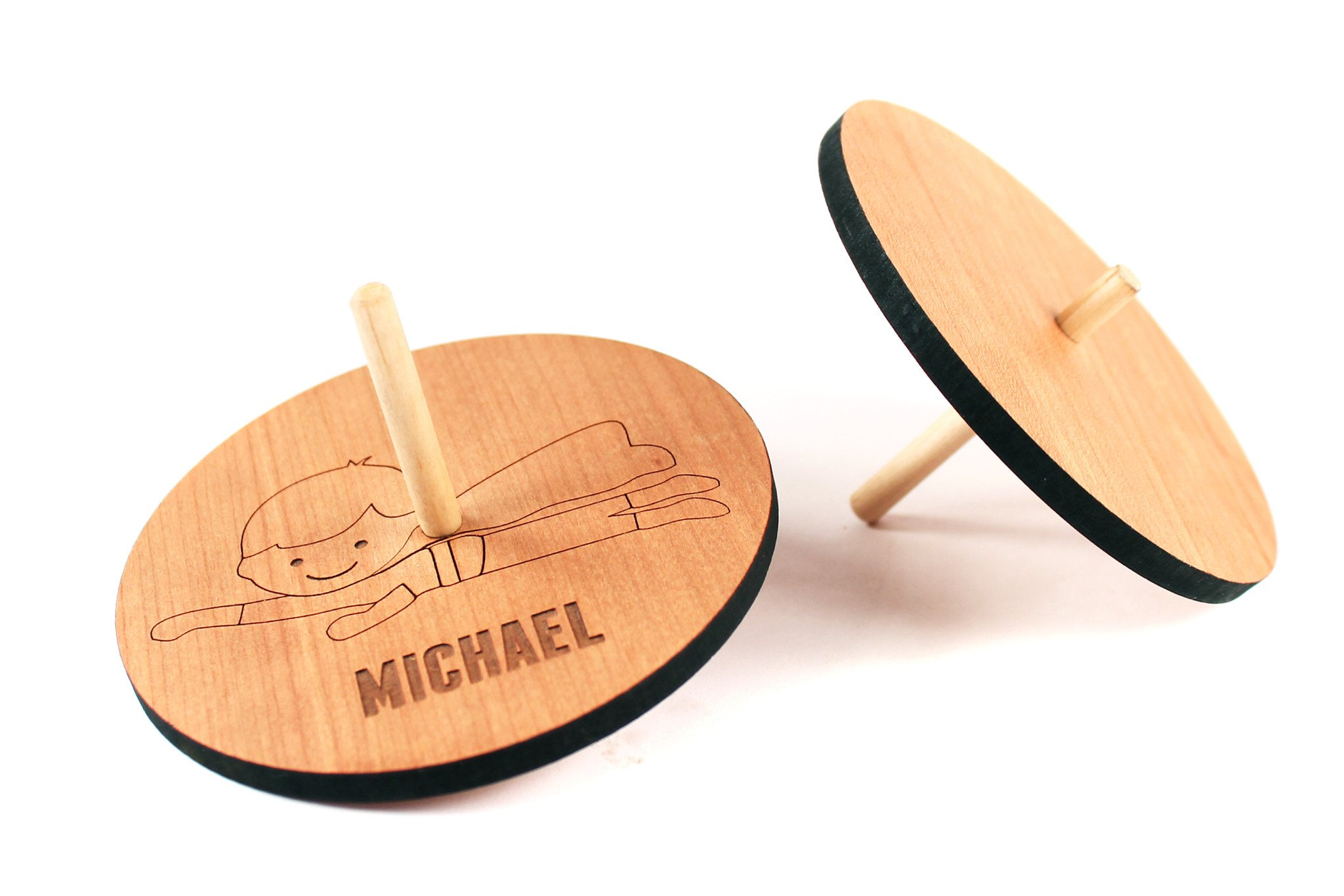 spinning wooden toy top - Smiling Tree