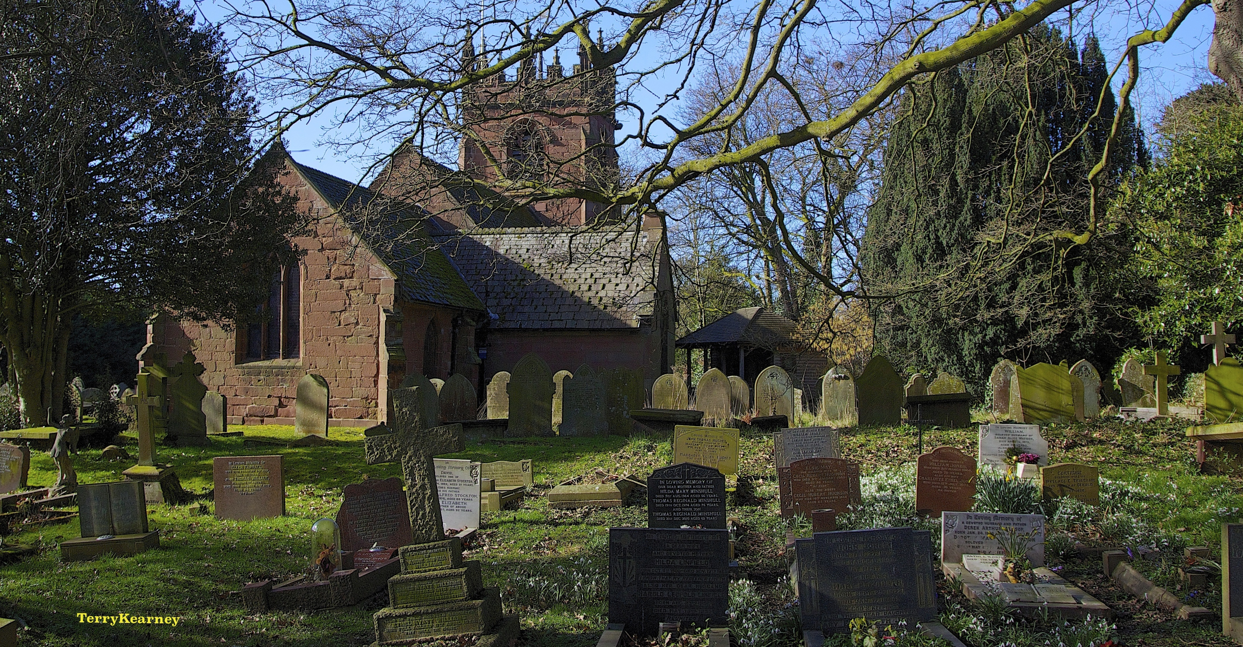 St oswald's churchyard at backford cheshire photo