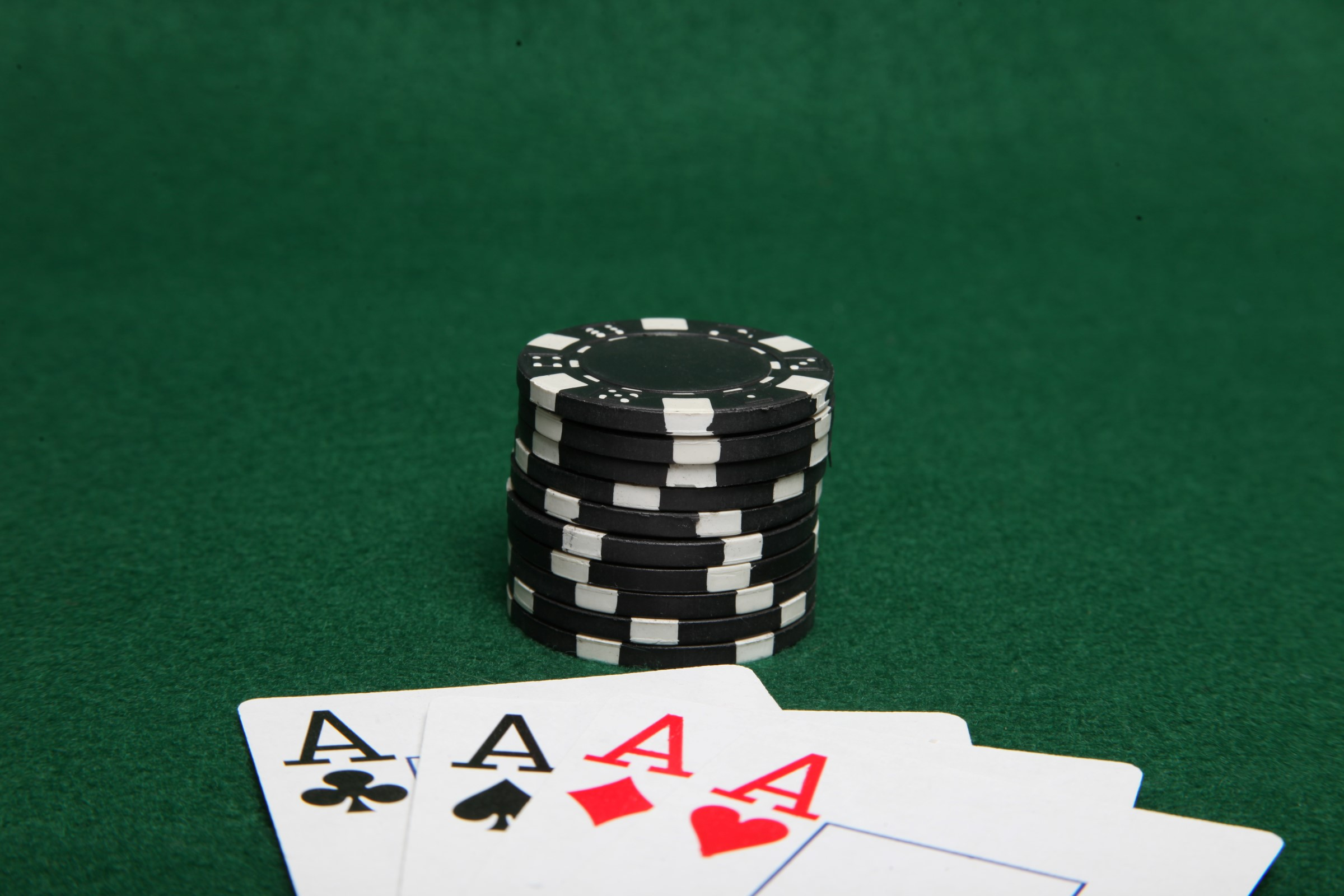 Stack of black poker chips with four ace photo
