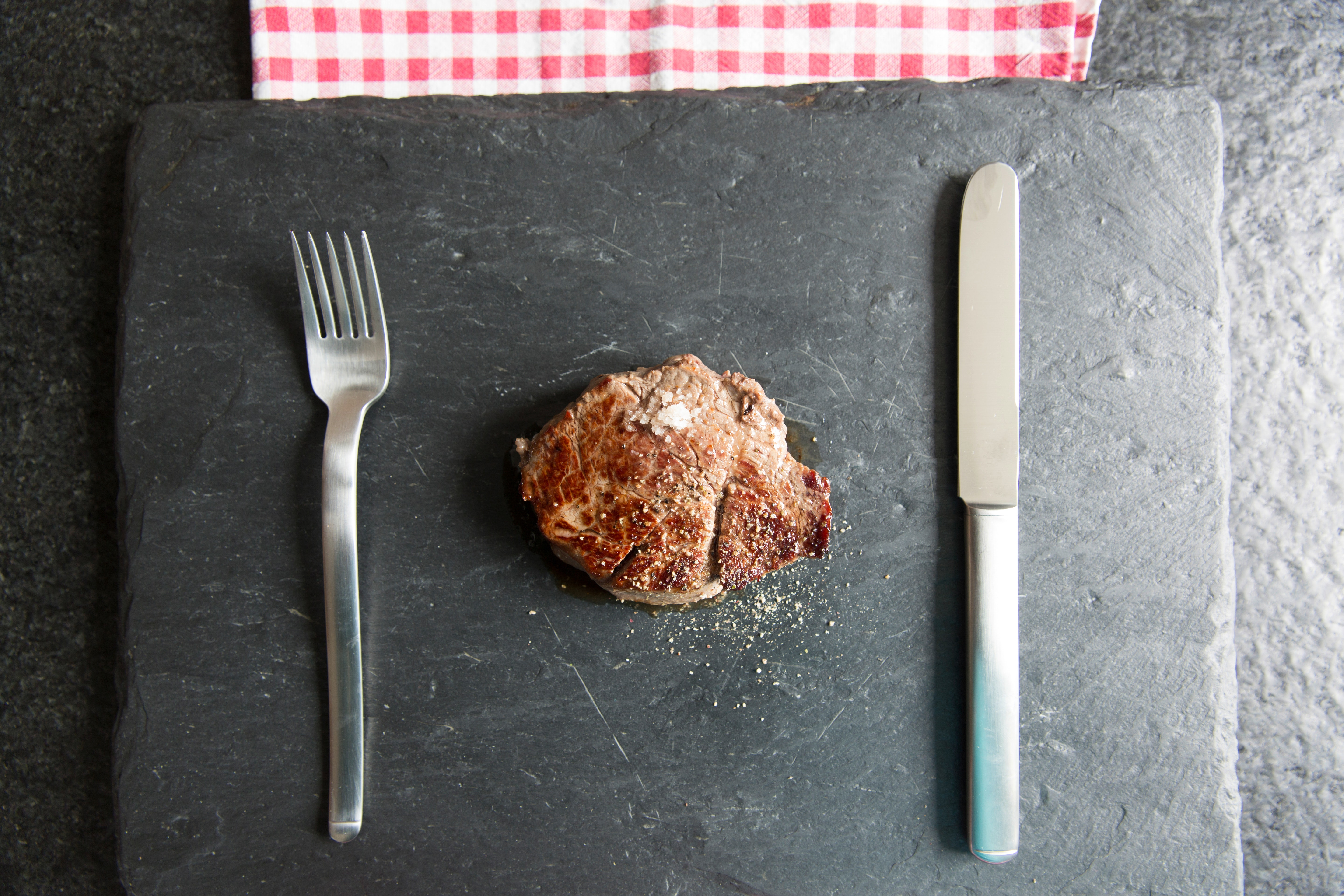 Stainless steel fork near grill meat photo