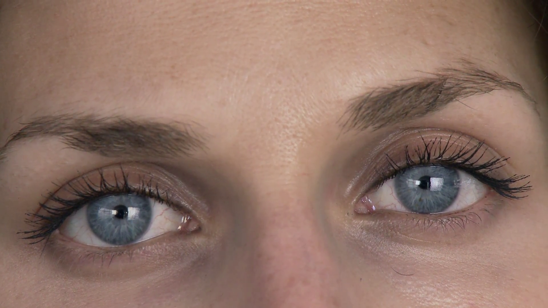 Girl staring with bright blue eyes Stock Video Footage - Videoblocks