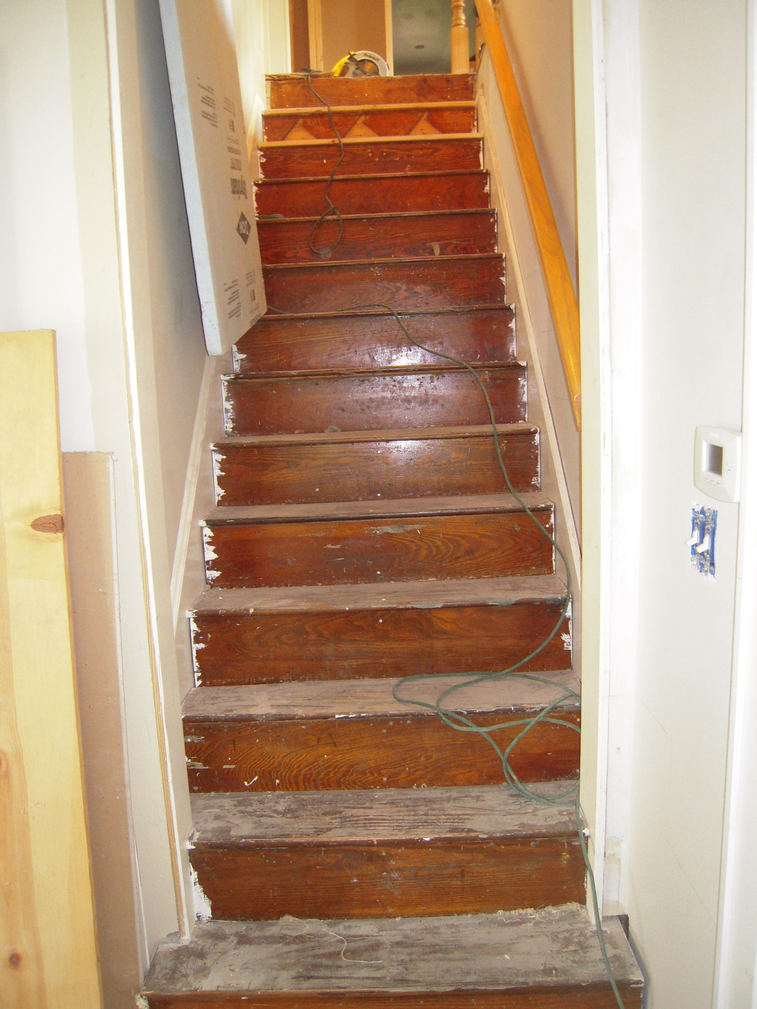 Steep wooden steps photo