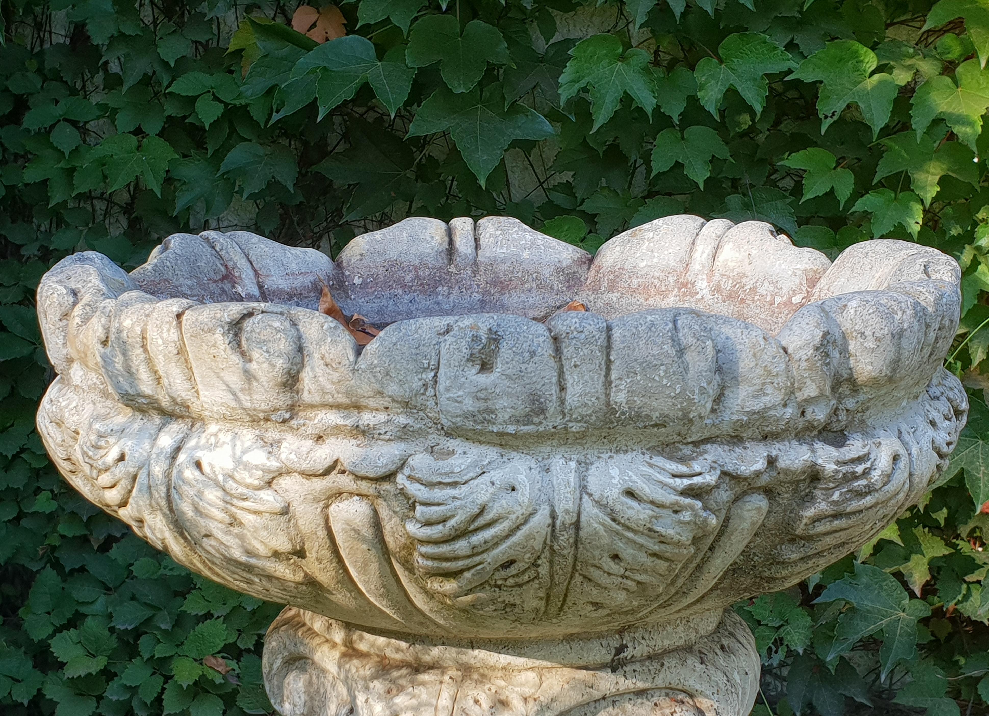 Stone vase in the garden photo