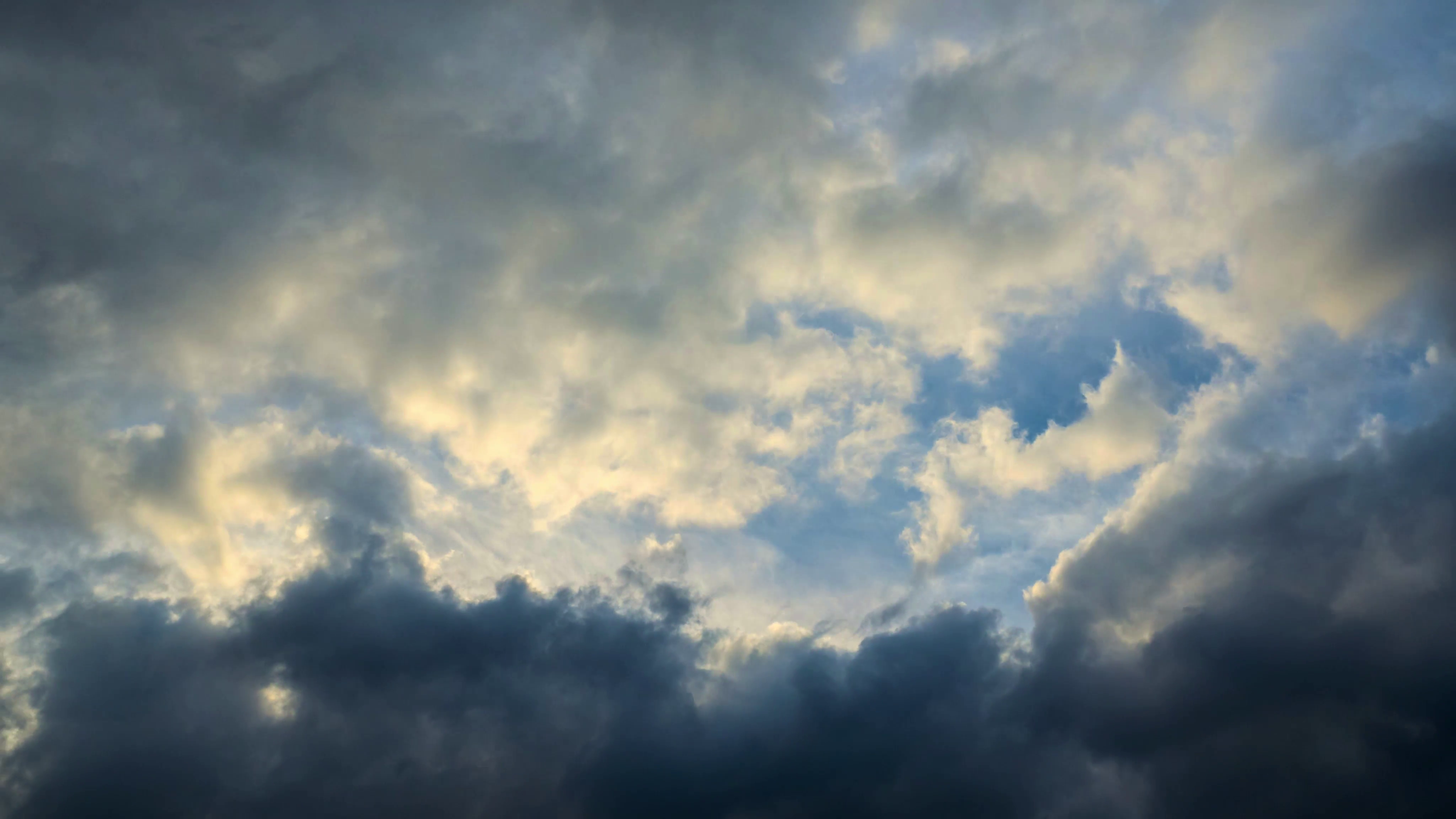 Dramatic storm clouds moving over sunset sky background. 4K UHD ...