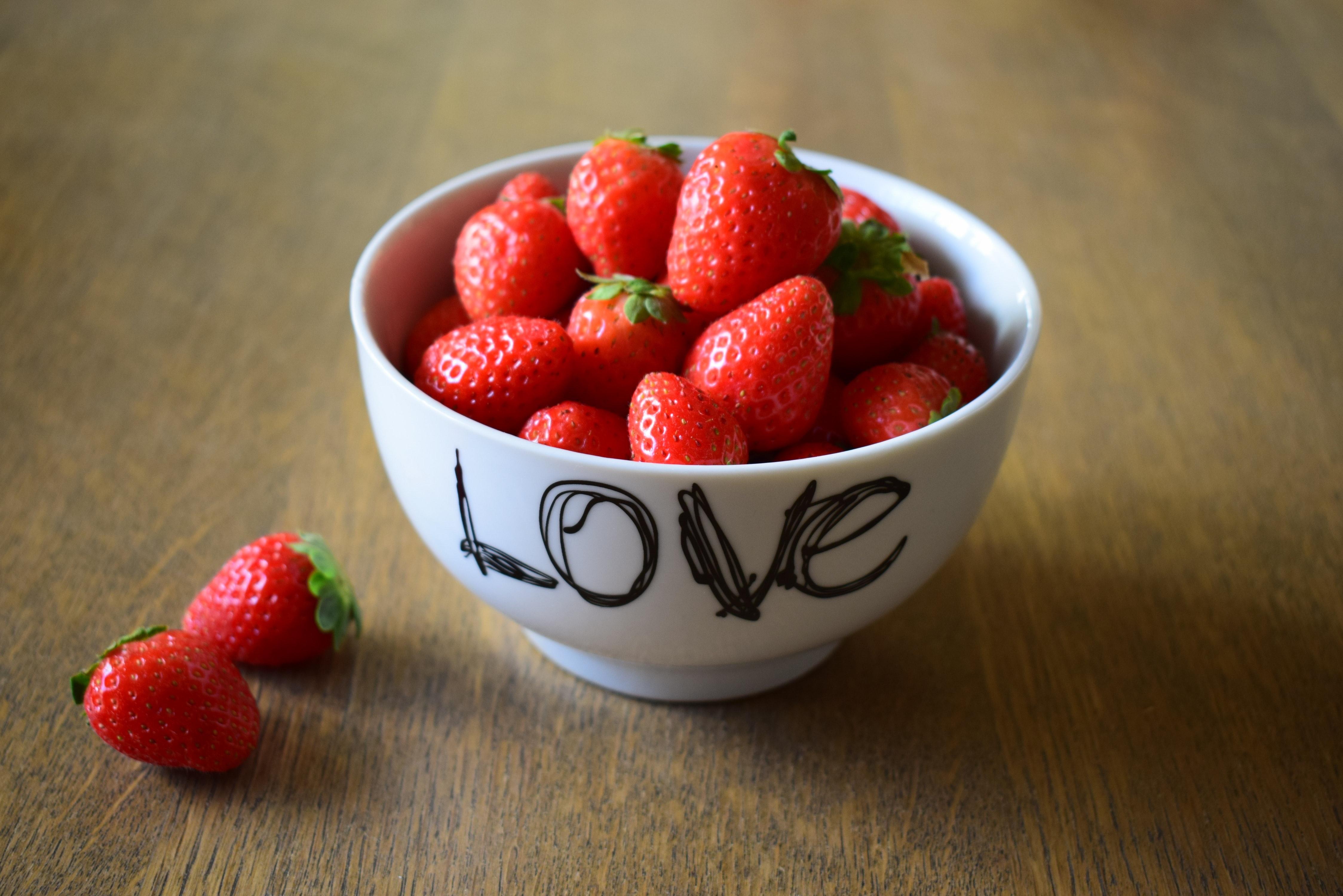 Strawberry on white ceramic bowl photo