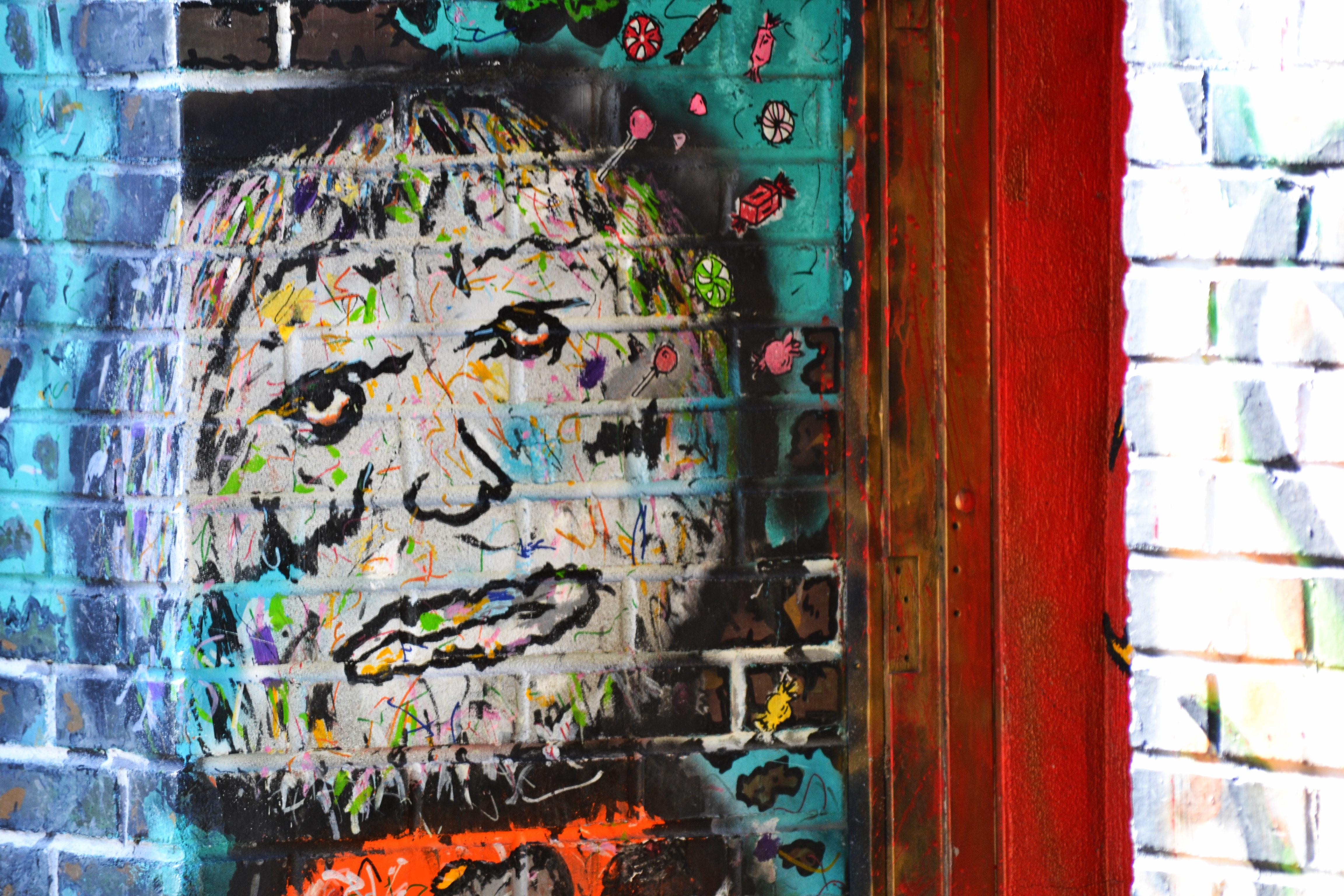 Street art of an evil face on a brick wall photo