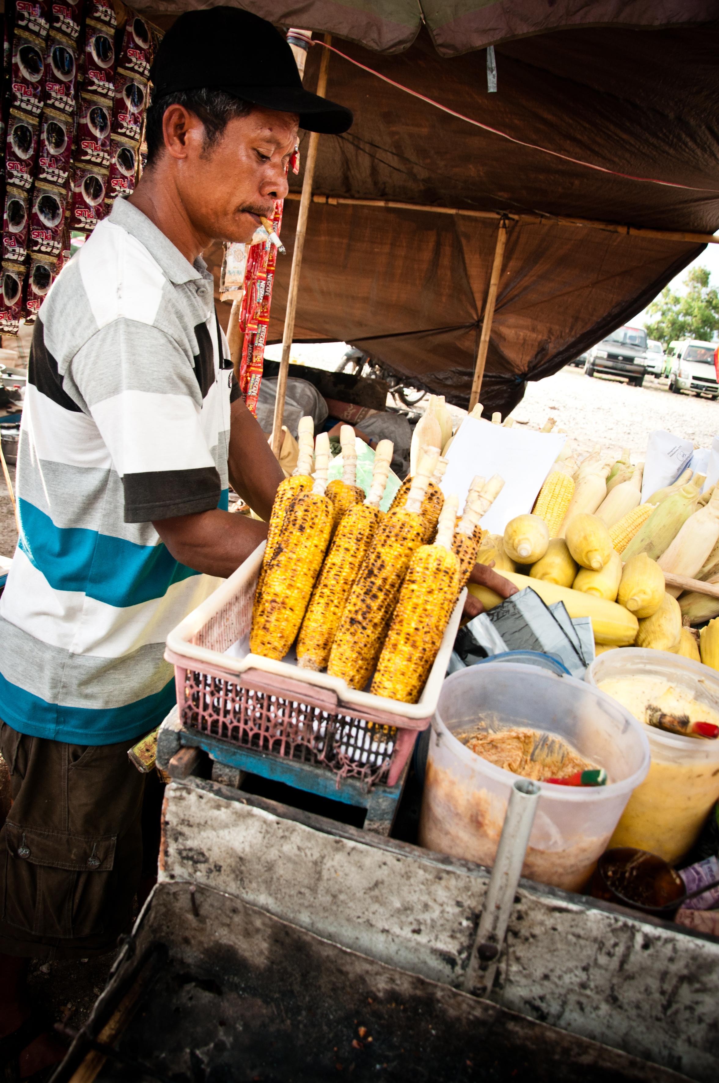 Street vendor selling corn on the street photo