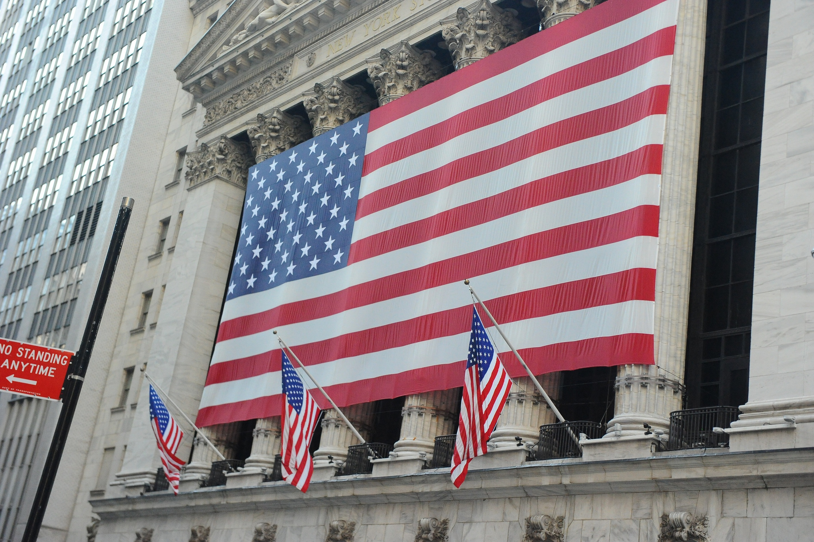 Wall Street adorned with US flags | Caravan