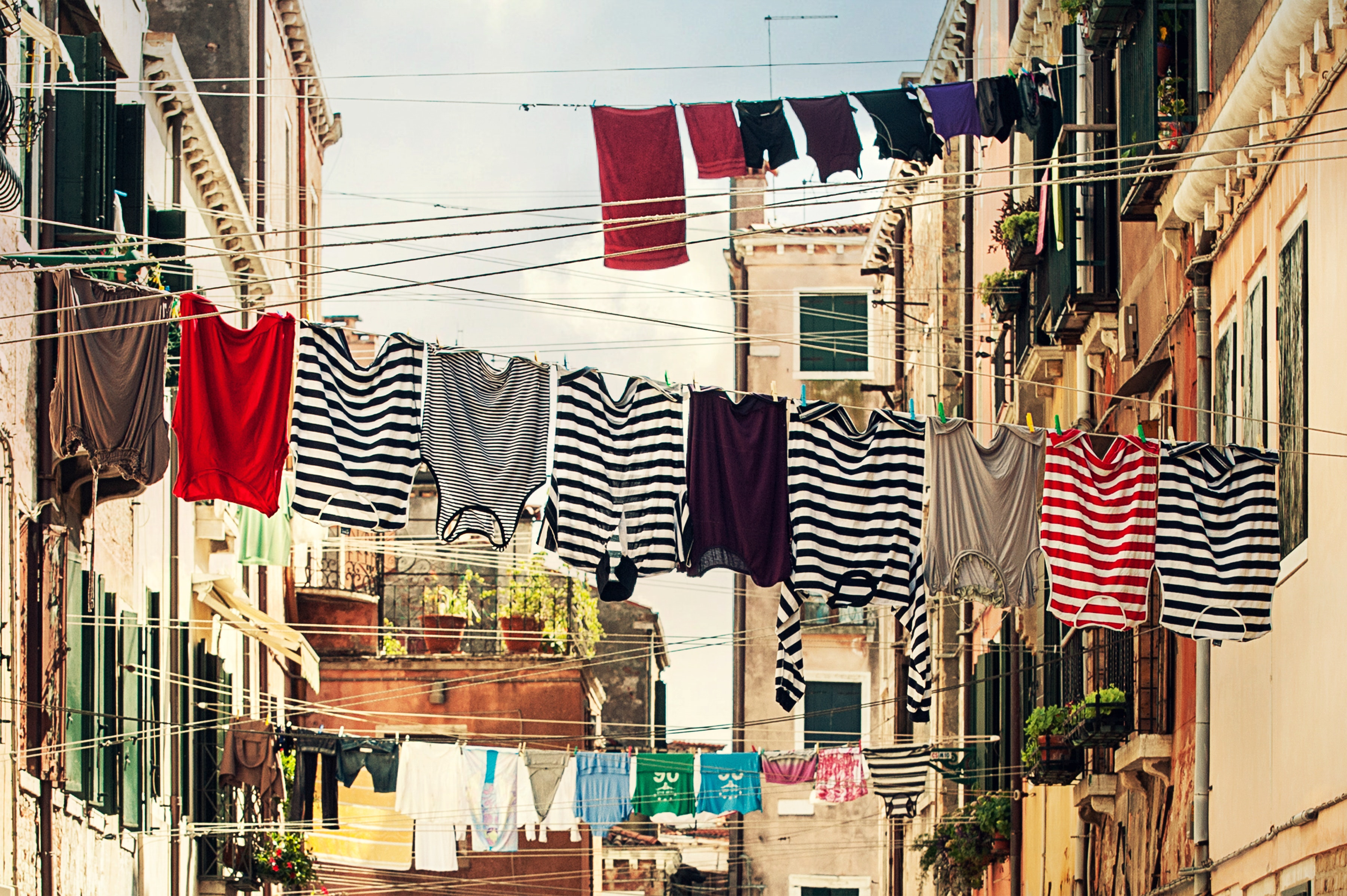 Striped Shirt Hanging on Gray Wire Between Beige Painted Wall Building during Daytime, Buildings, Clothes, Clothes line, Laundry, HQ Photo