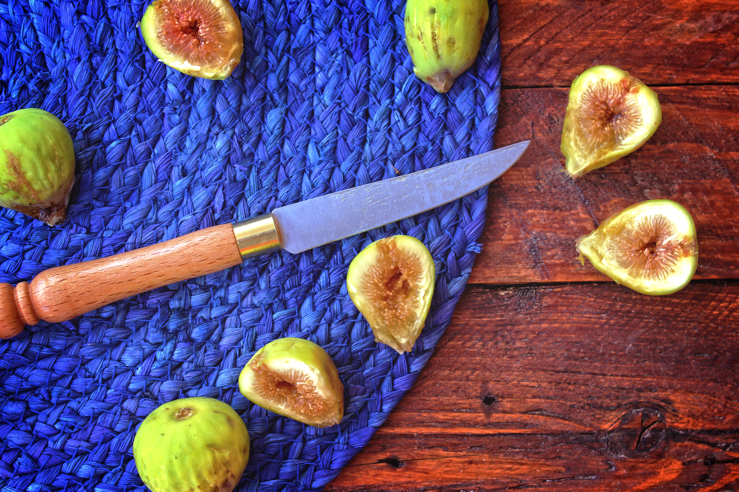 Summer s end - the last wild figs of the season sliced on the table photo
