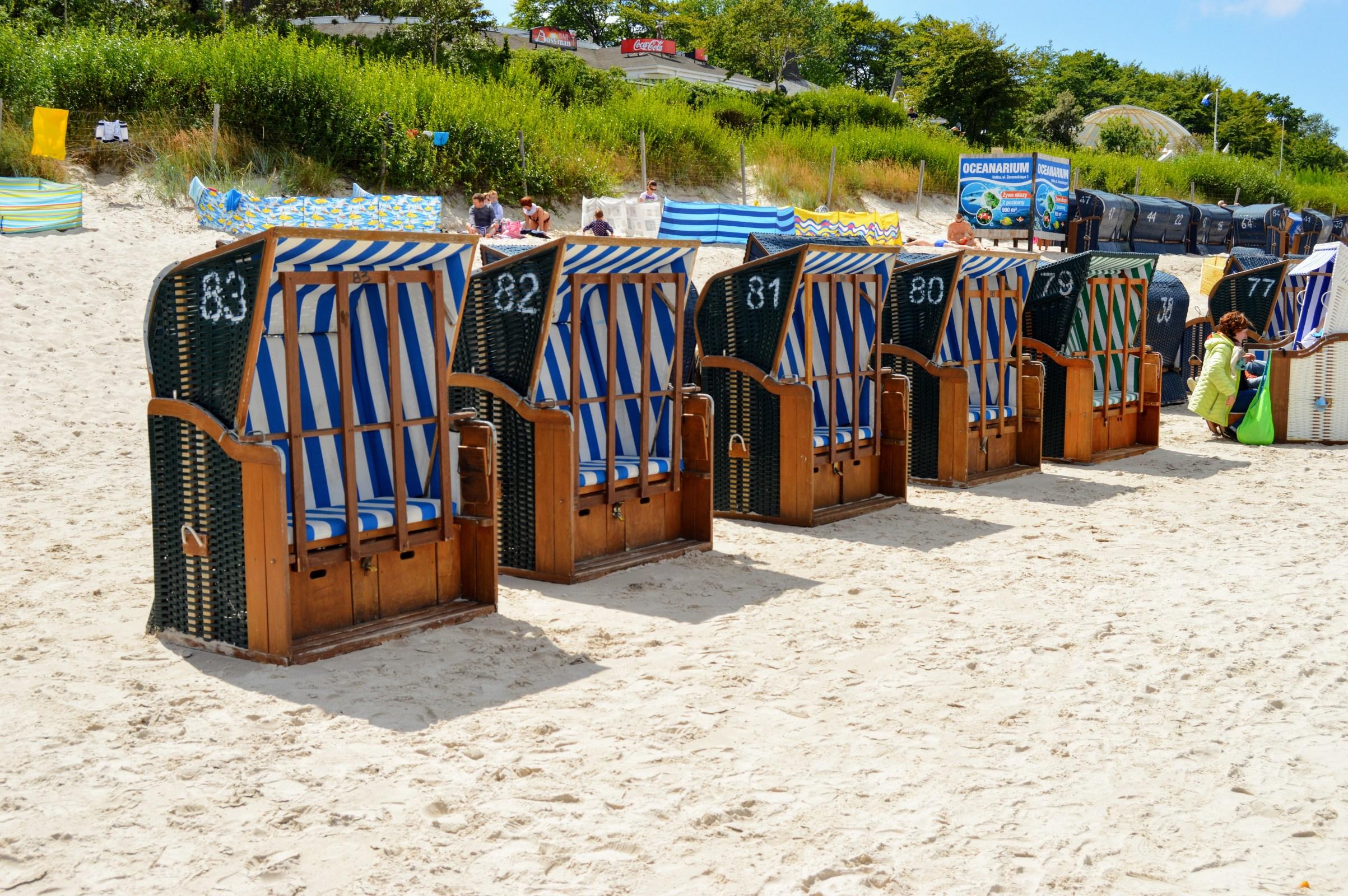 Sun beds - basket on a sandy beach photo