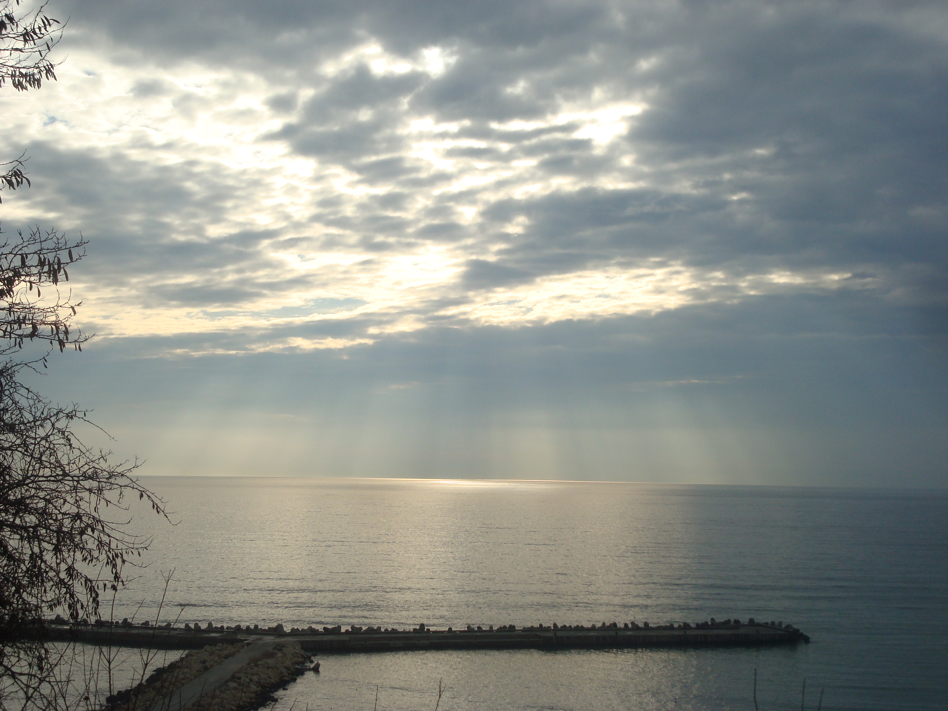 Sun rays over the sea photo