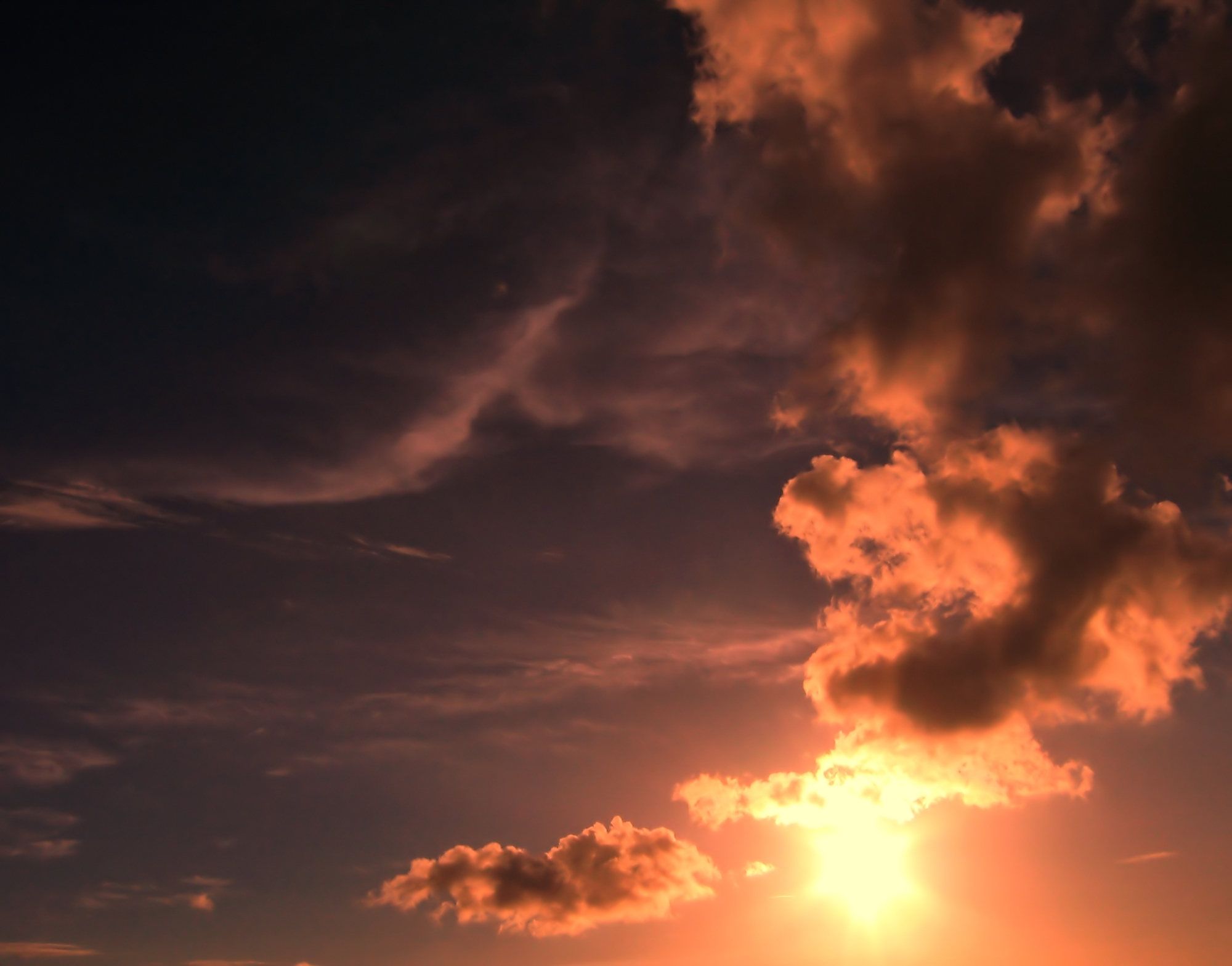 Sunset and gathering storm photo