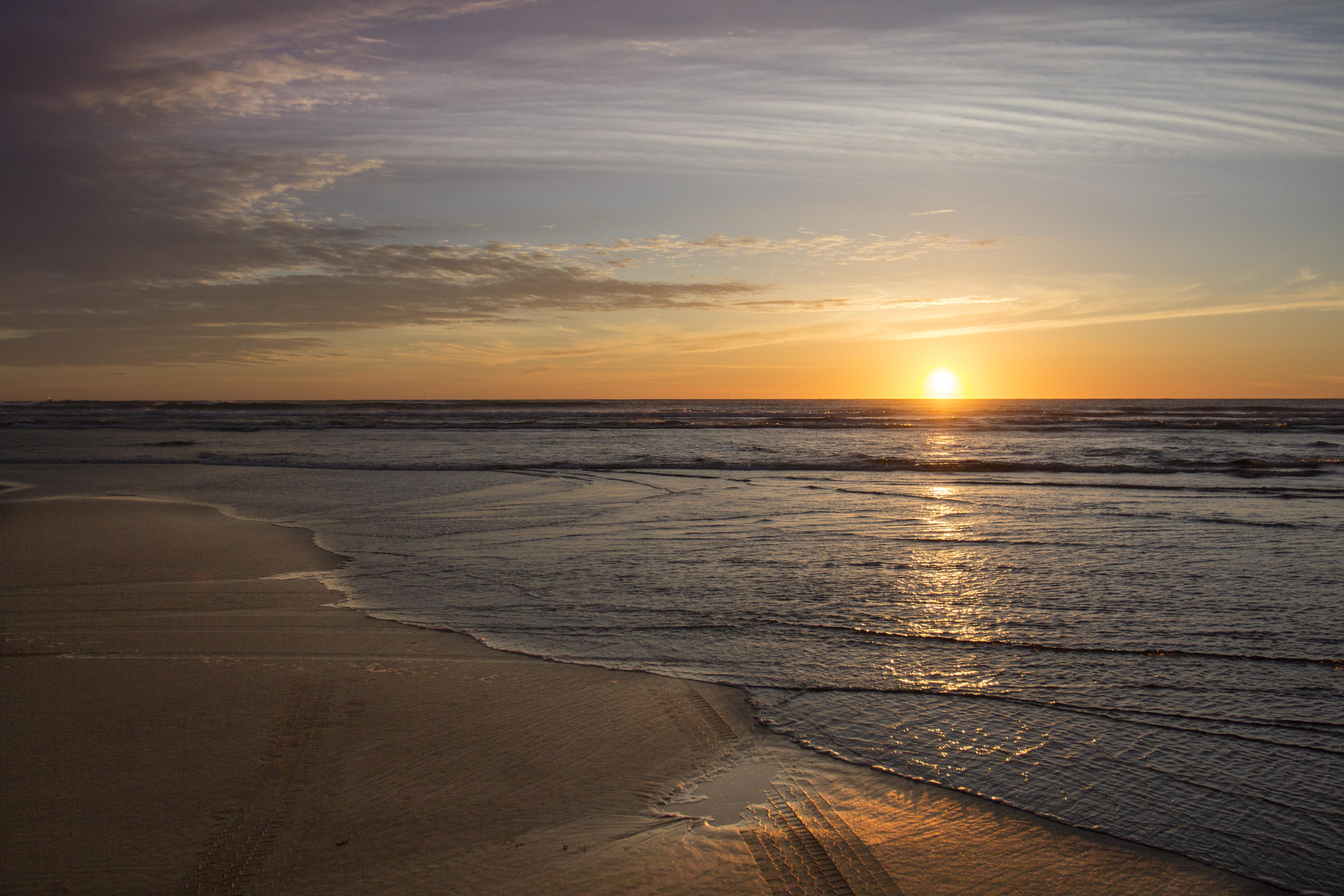 Sunset at oregon coast in february. photo