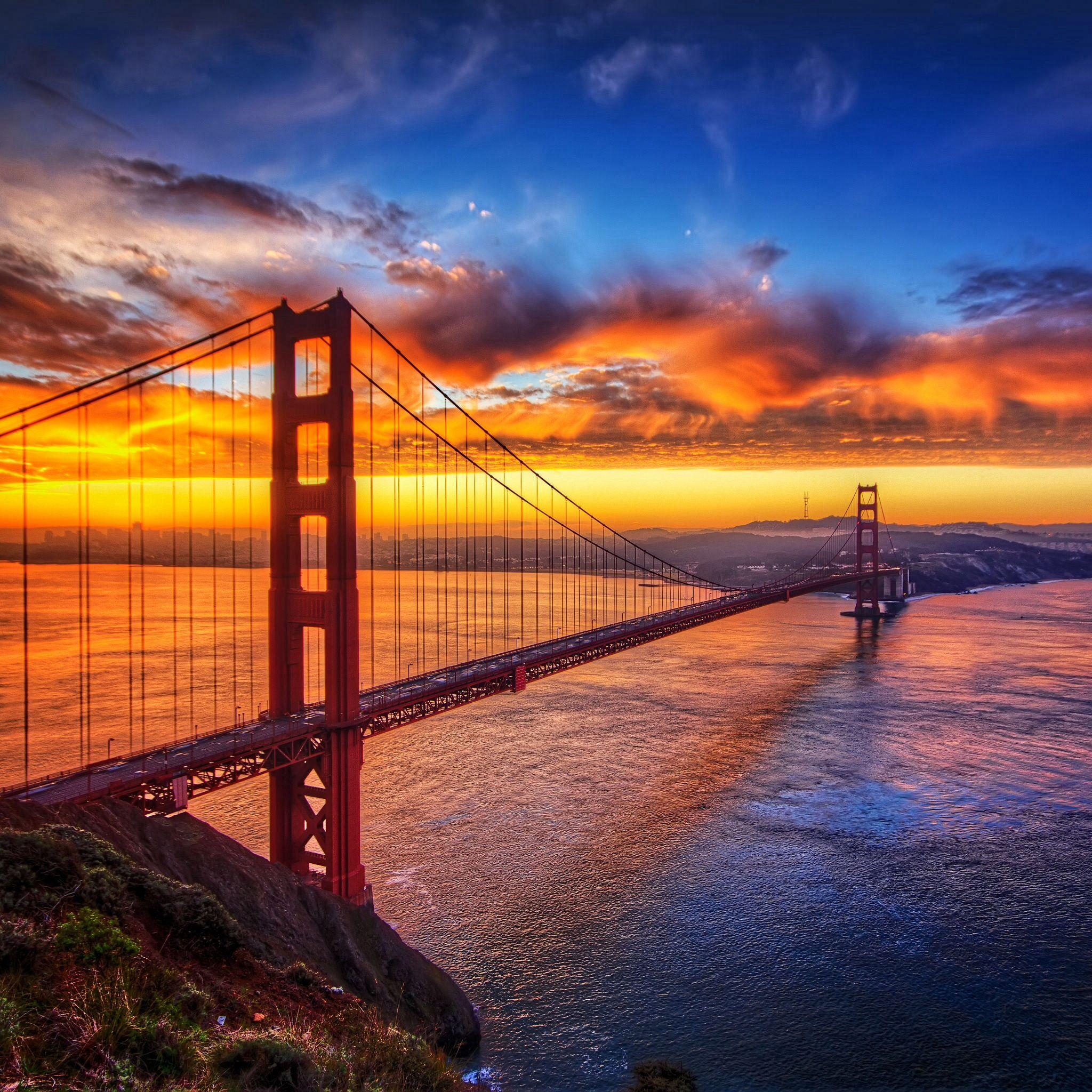 Sunset behind bridge photo
