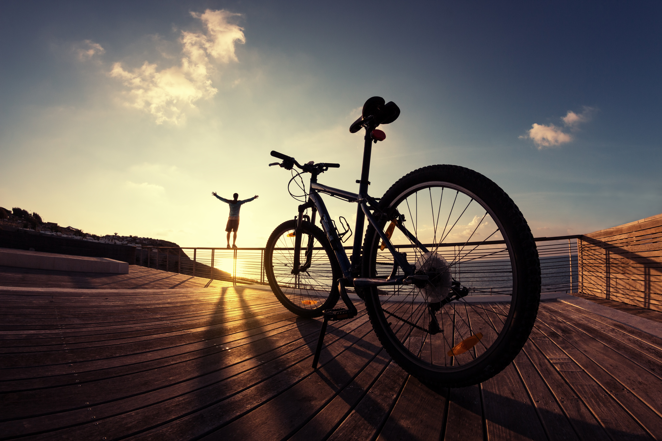 silhouette of sportsman and mountain bike at sunset | Boulder Bike Tours