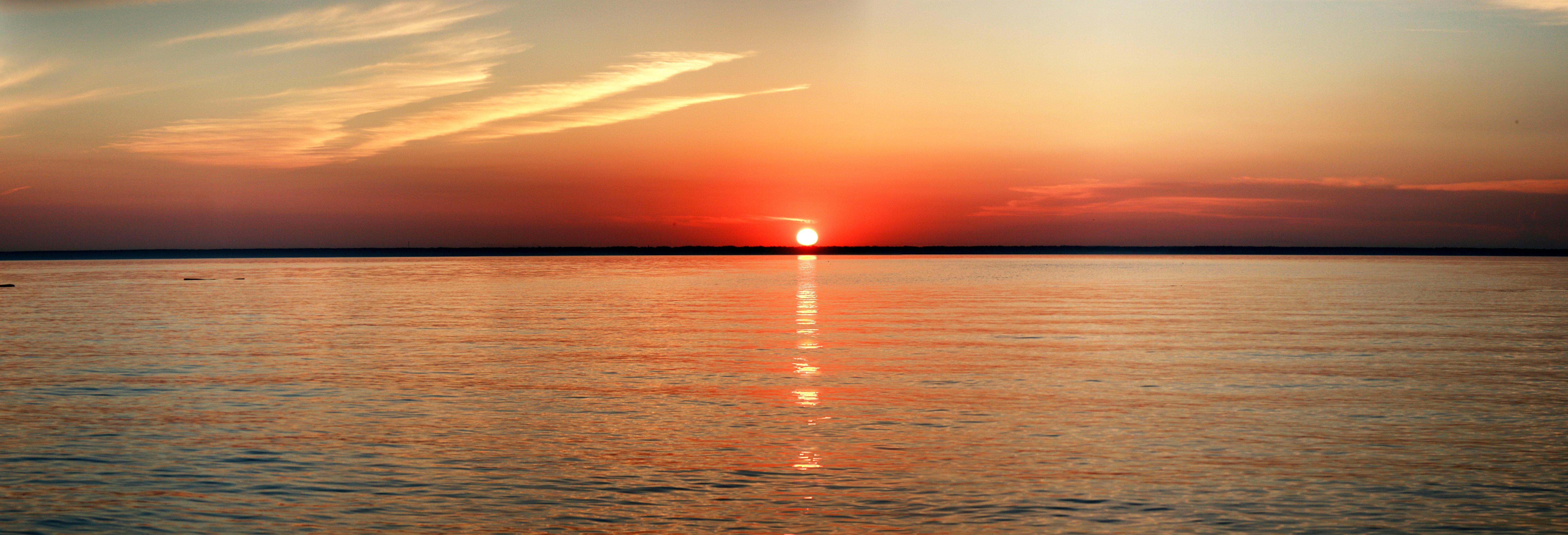 Sunset on the edge of ocean photo