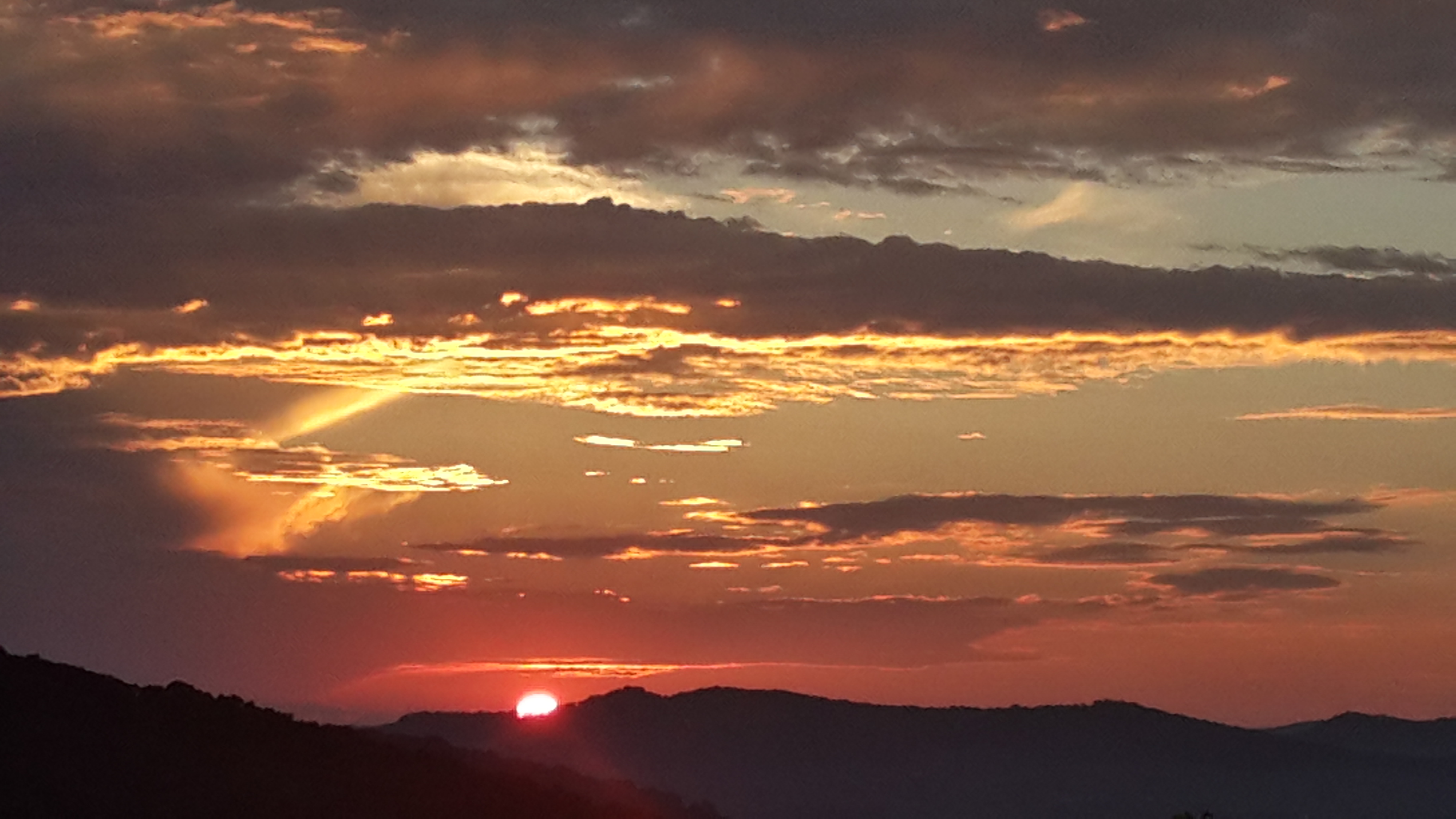 Sunset over the hills photo