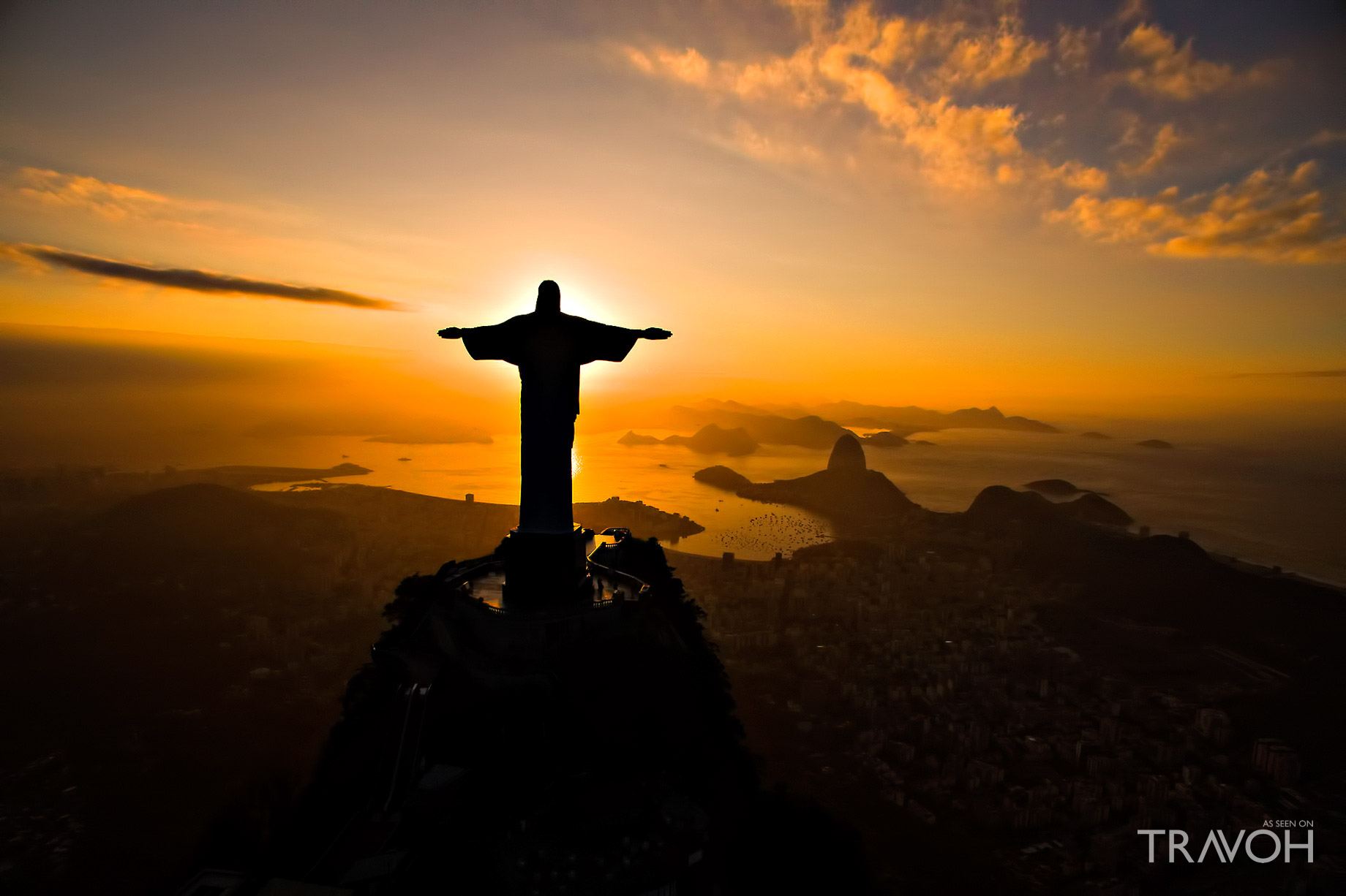 A Dramatic Sunset Illuminates the Statue of Jesus on Top of ...