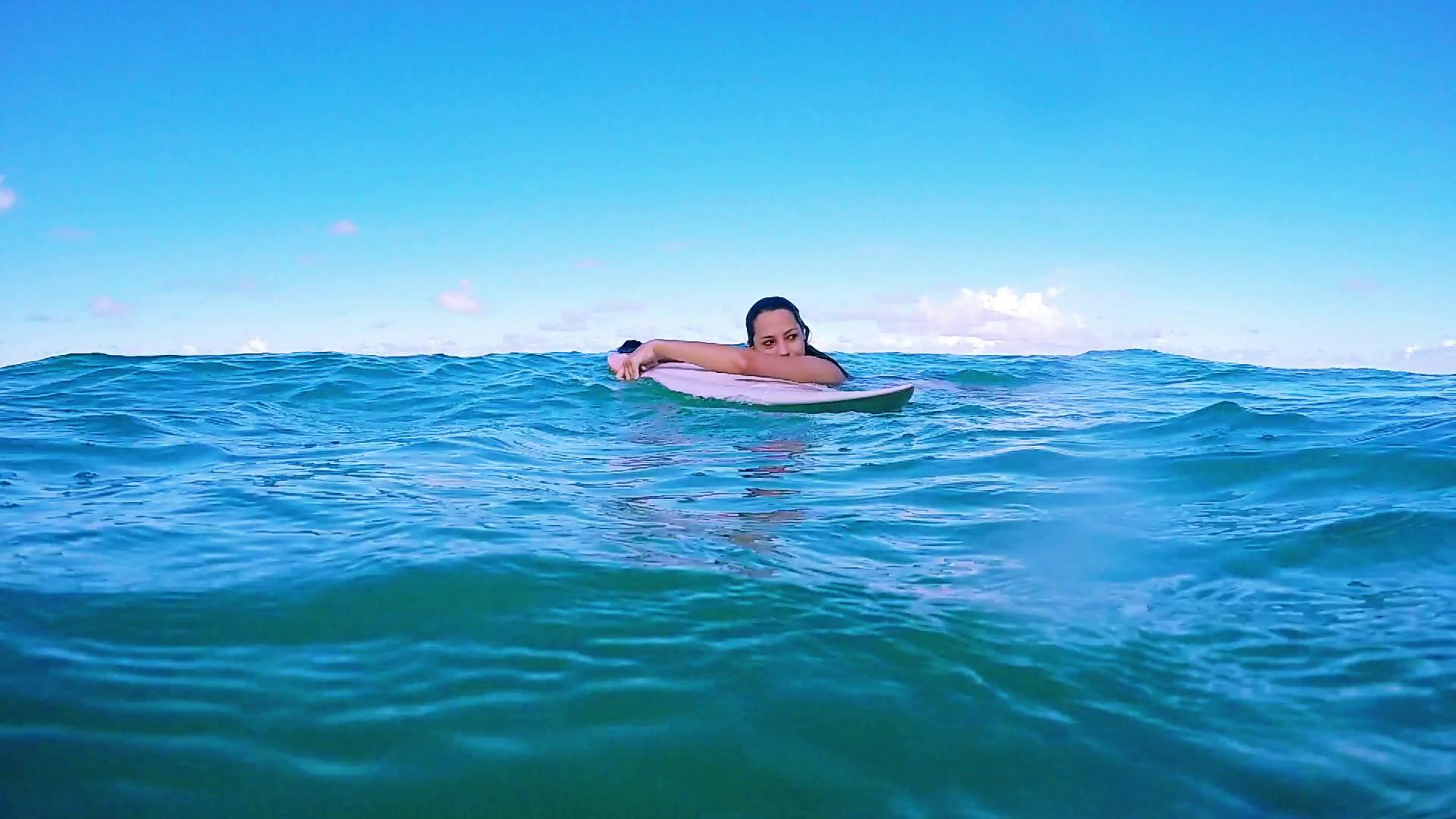 Surfboard floating photo