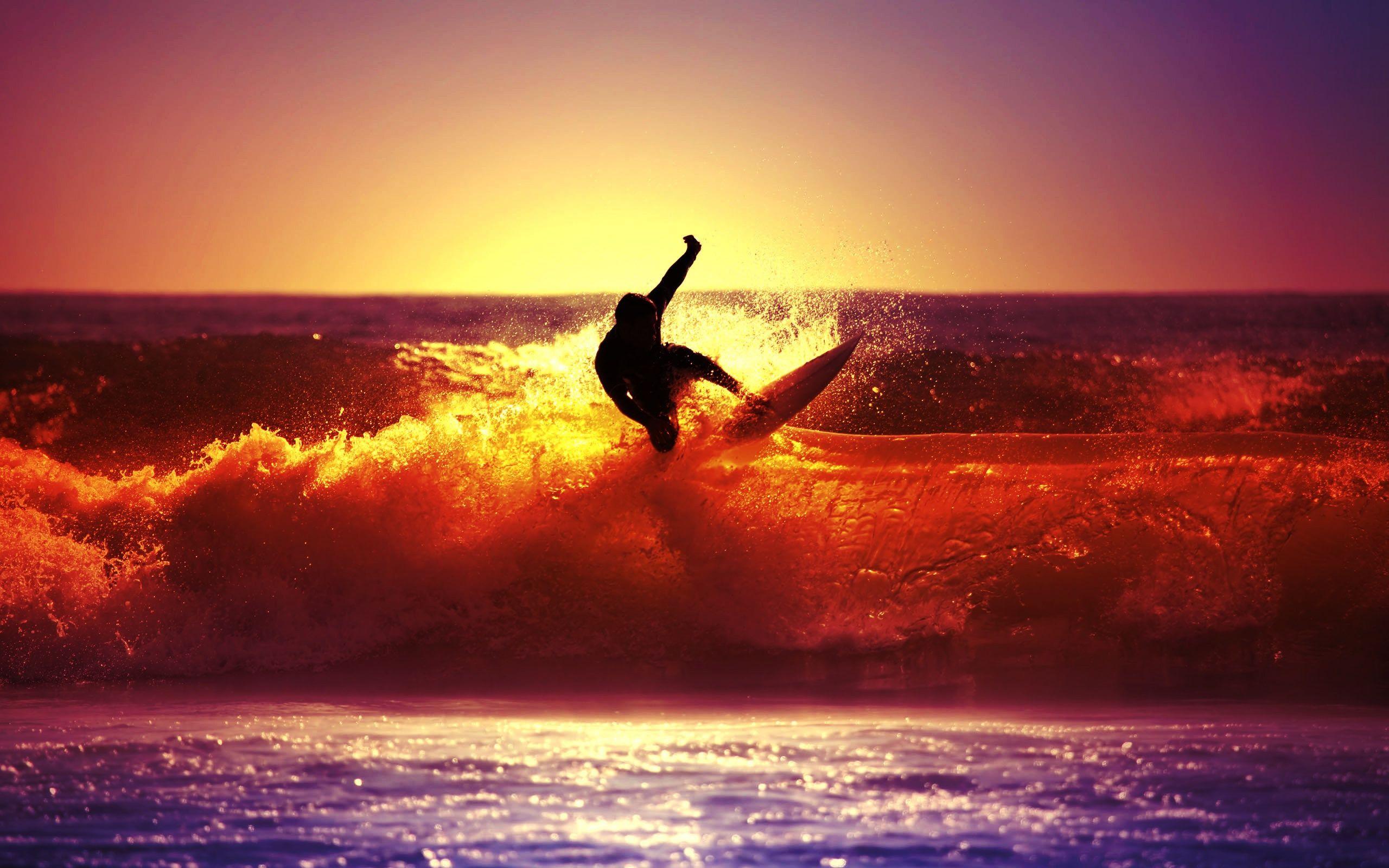 Surfer at sunset photo