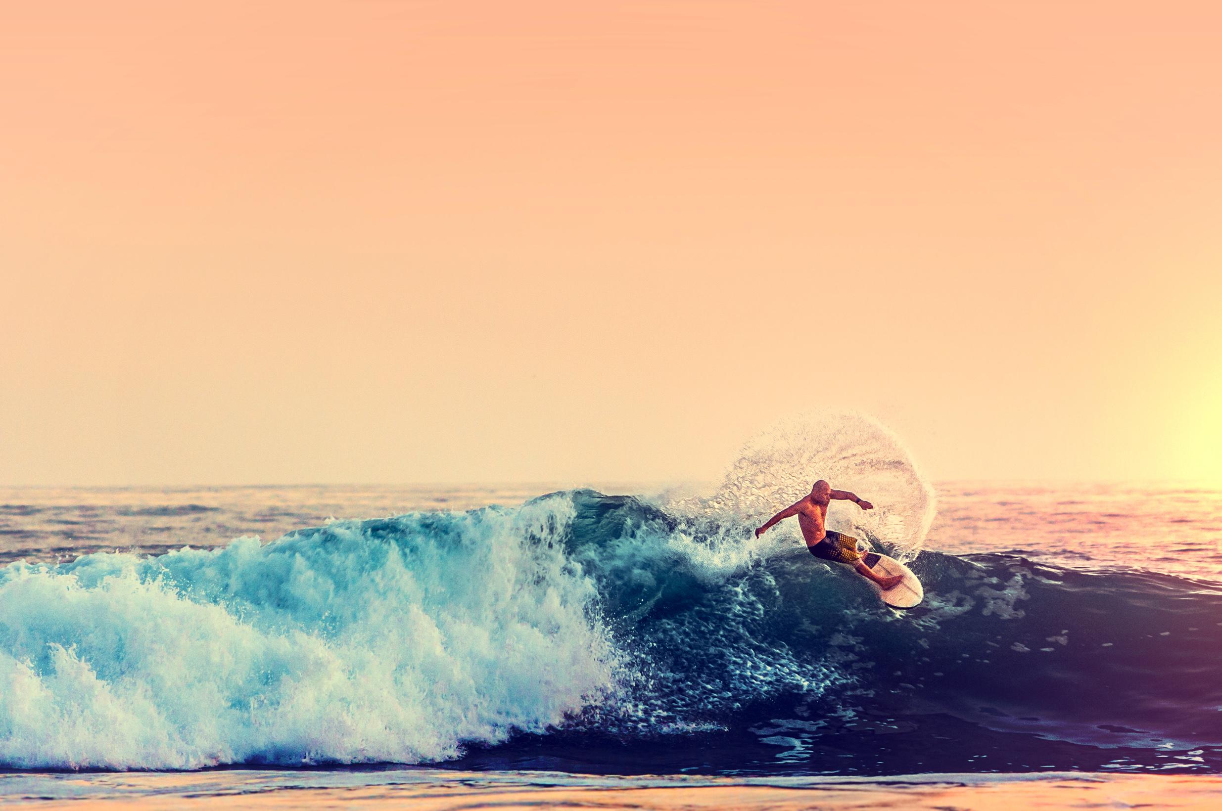 Surfer at sunset - color filtered photo