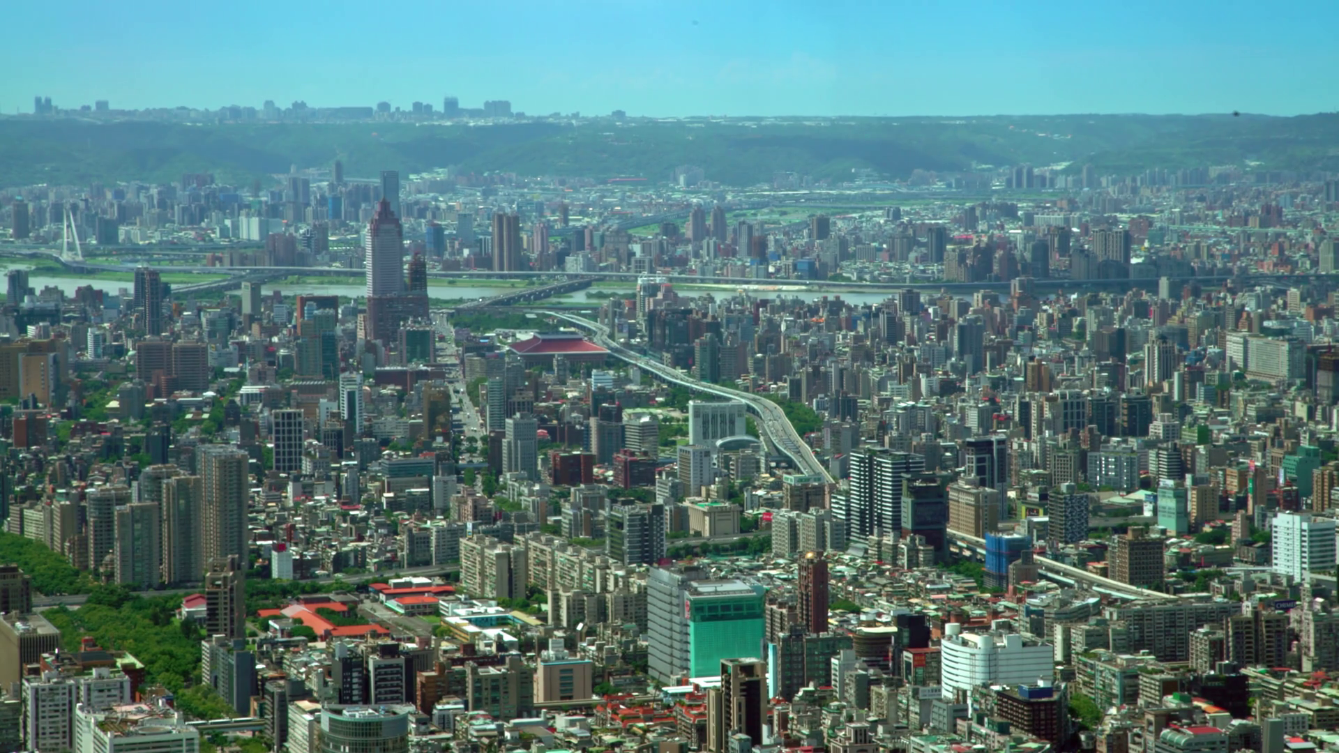 4K Aerial view of the Downtown Taipei city buildings with mountains ...