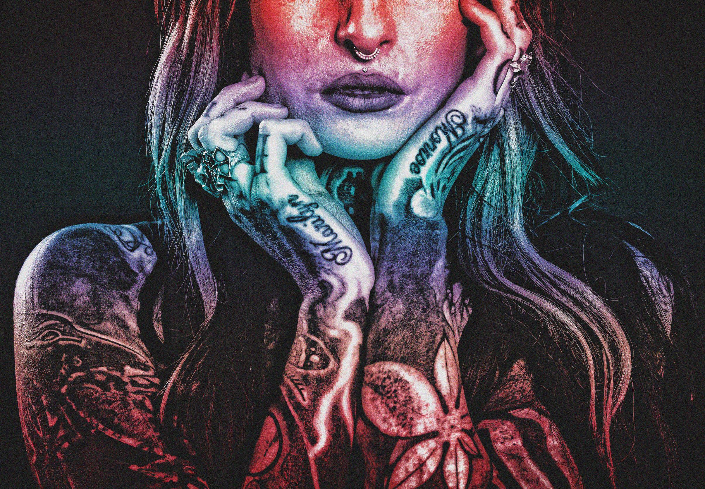 Tattooed woman - grunge noisy looks photo
