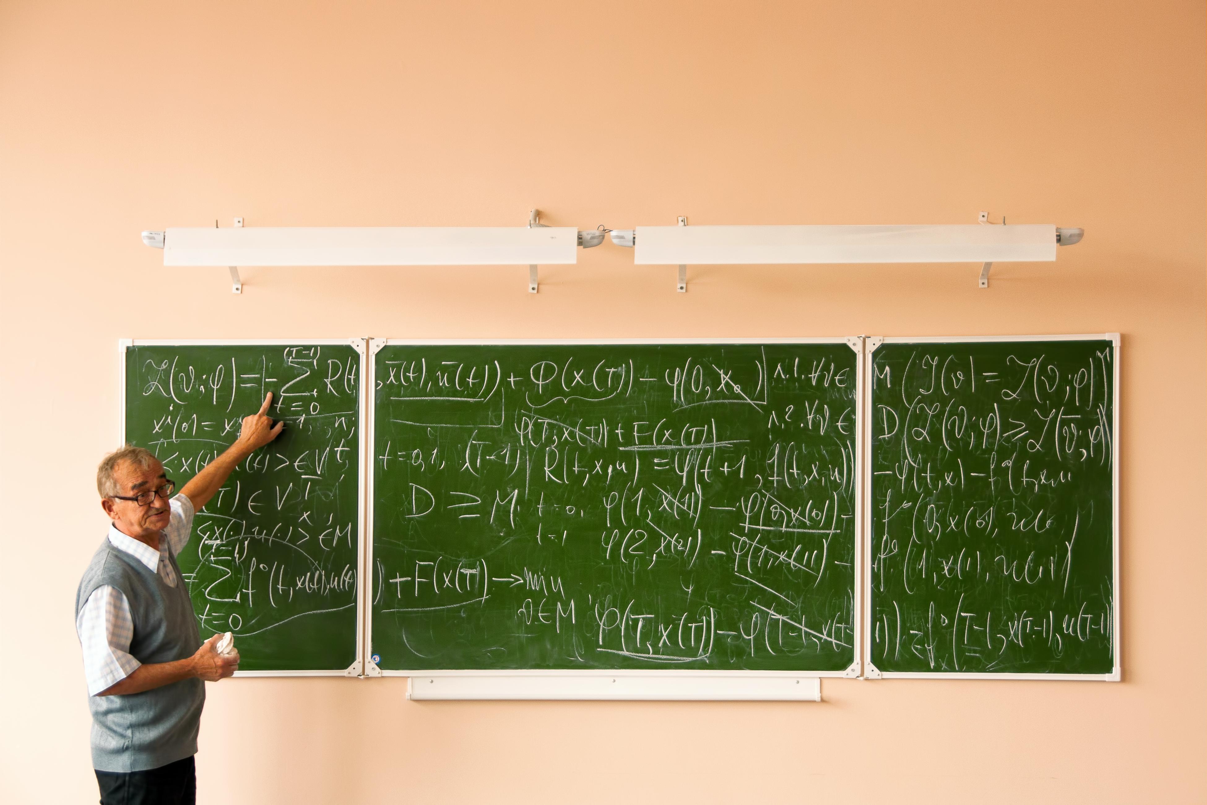 Teacher and formulas photo
