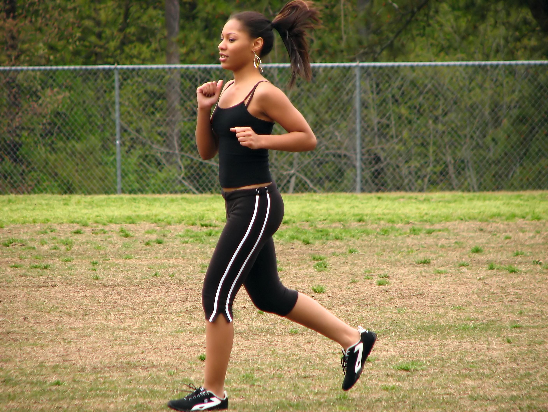 Teen african american girl running photo