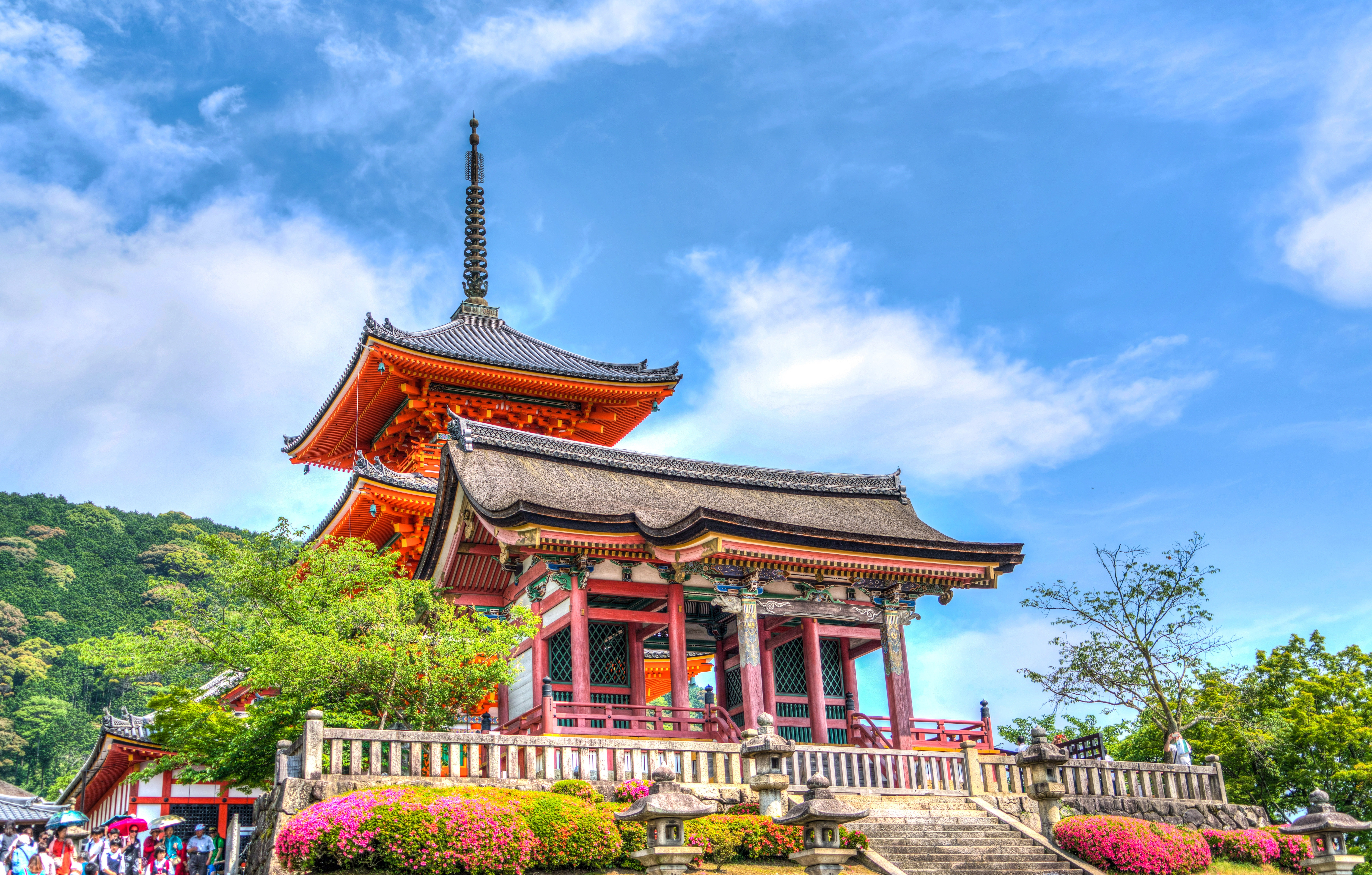 Temple on elevated area under blue sky and white clouds during daytime photo