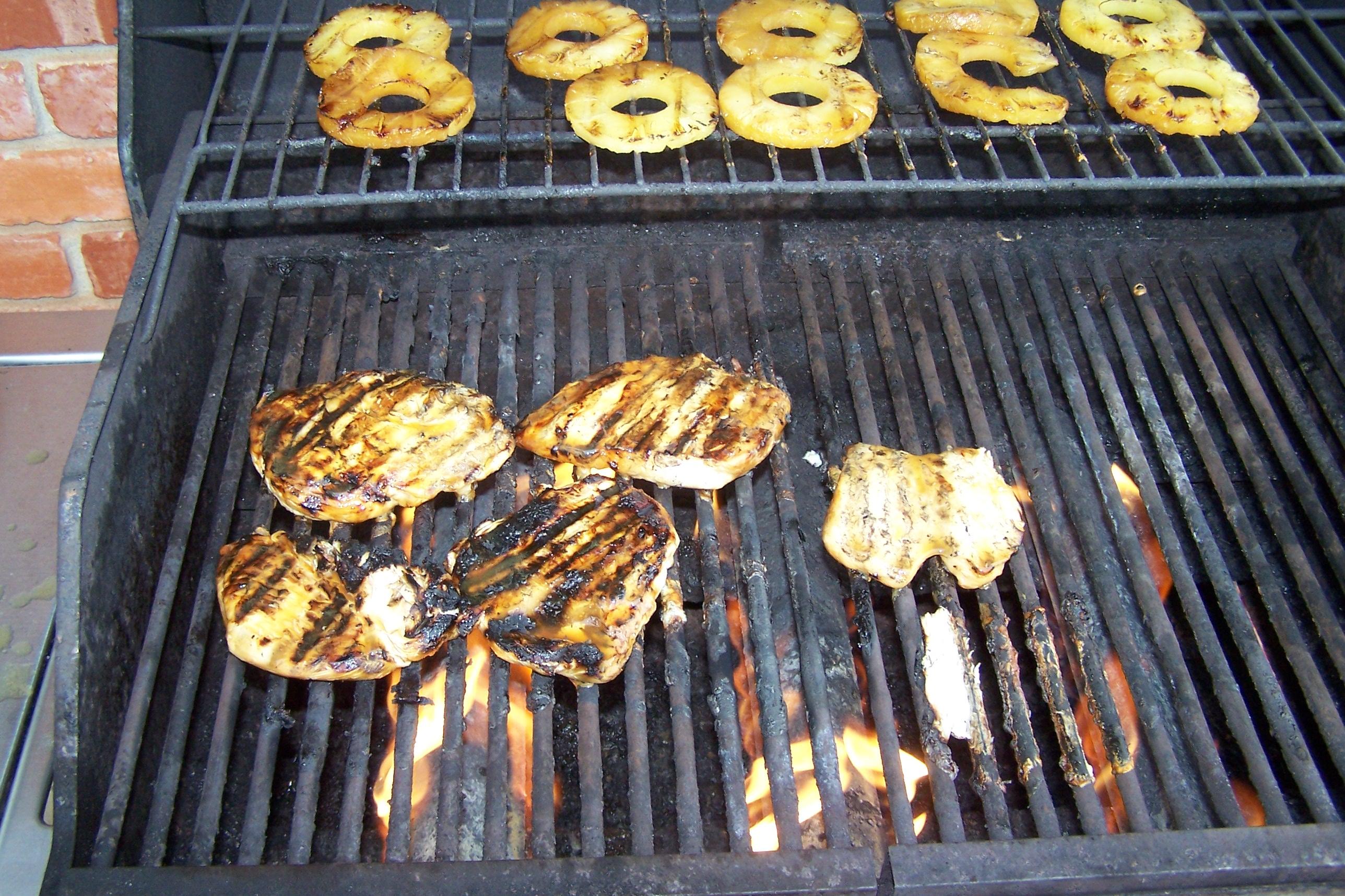 Teryaki chicken on grill photo