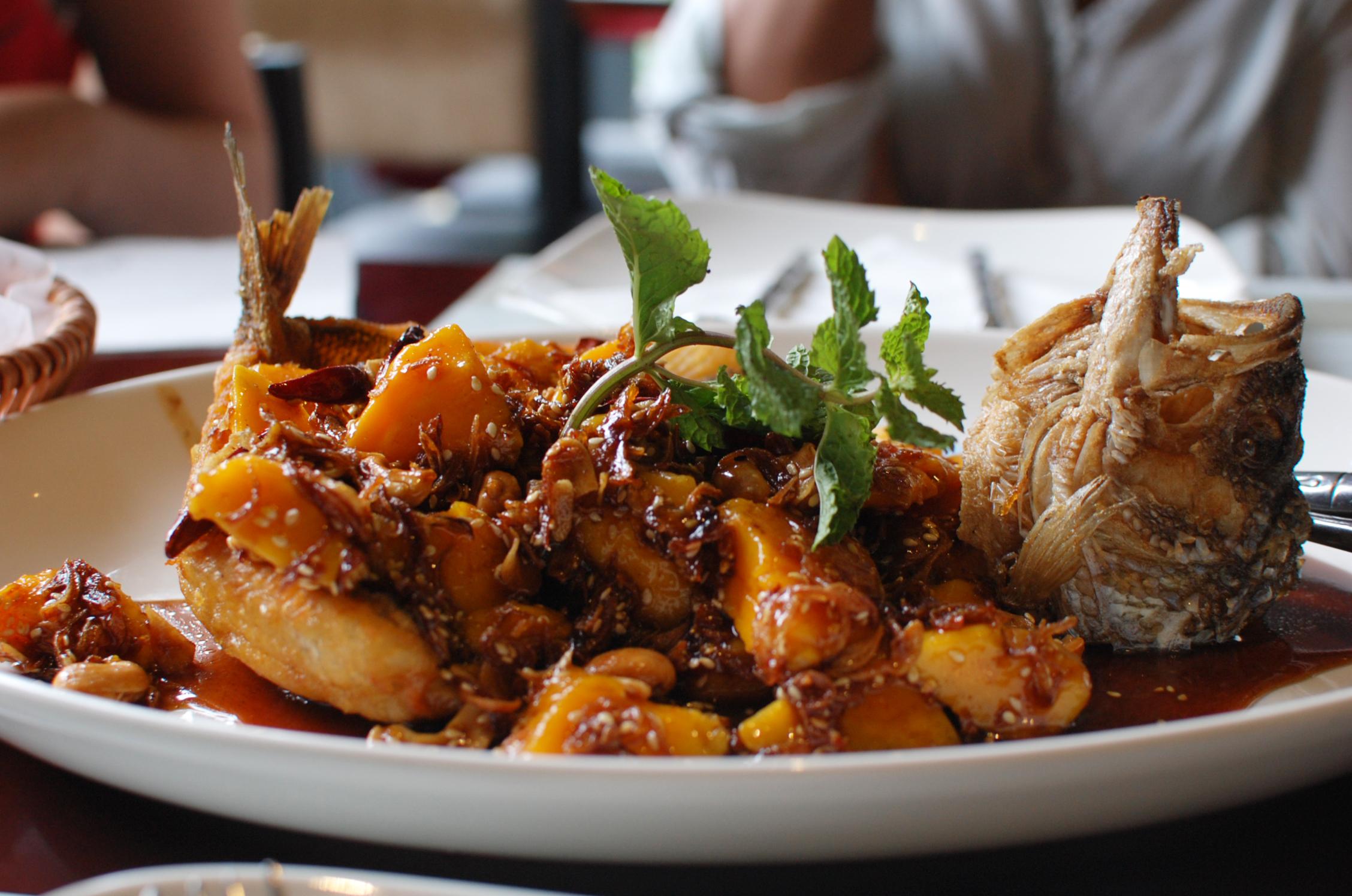 Thai fried fish with mango photo