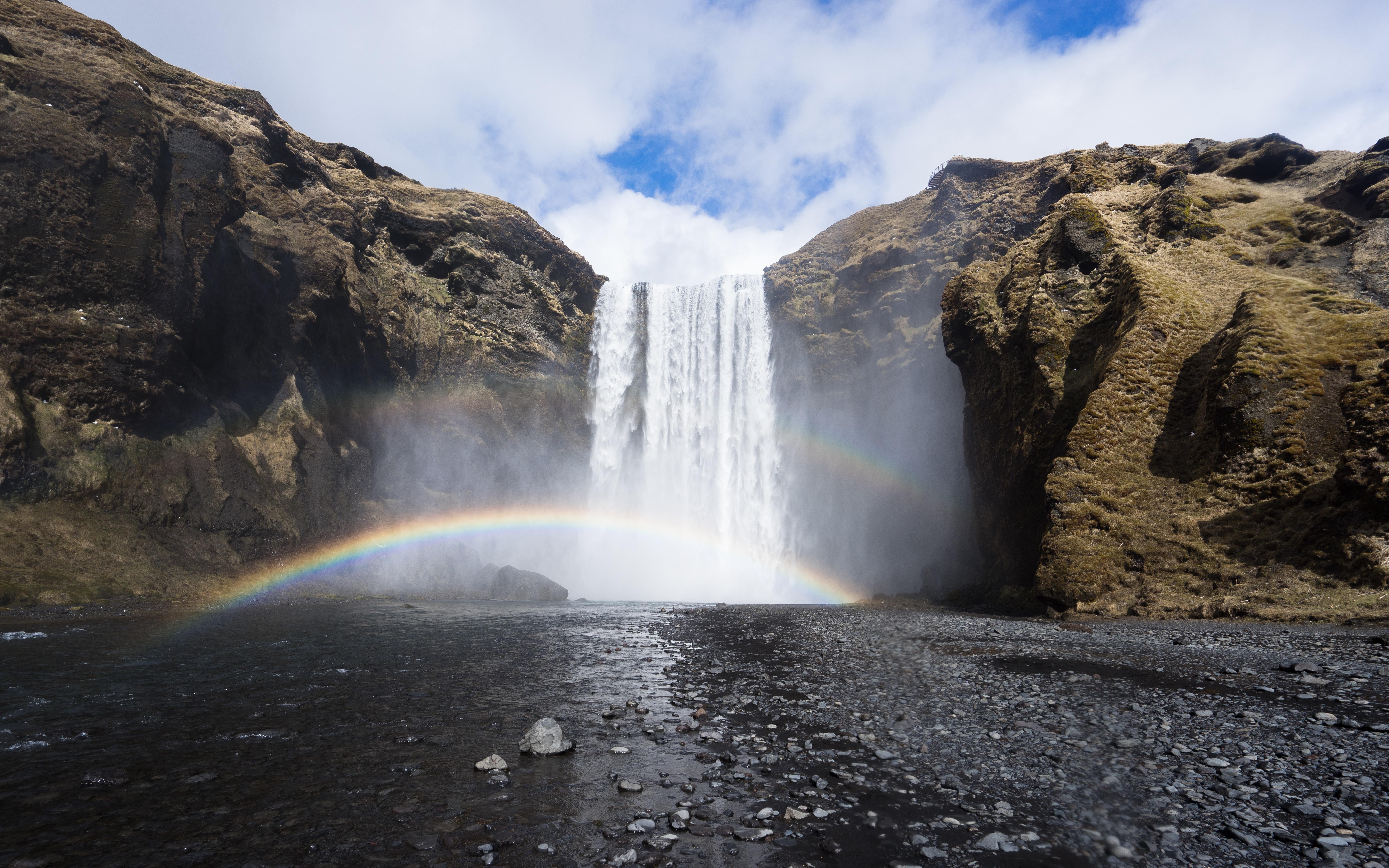The rainbow below the waterfall photo