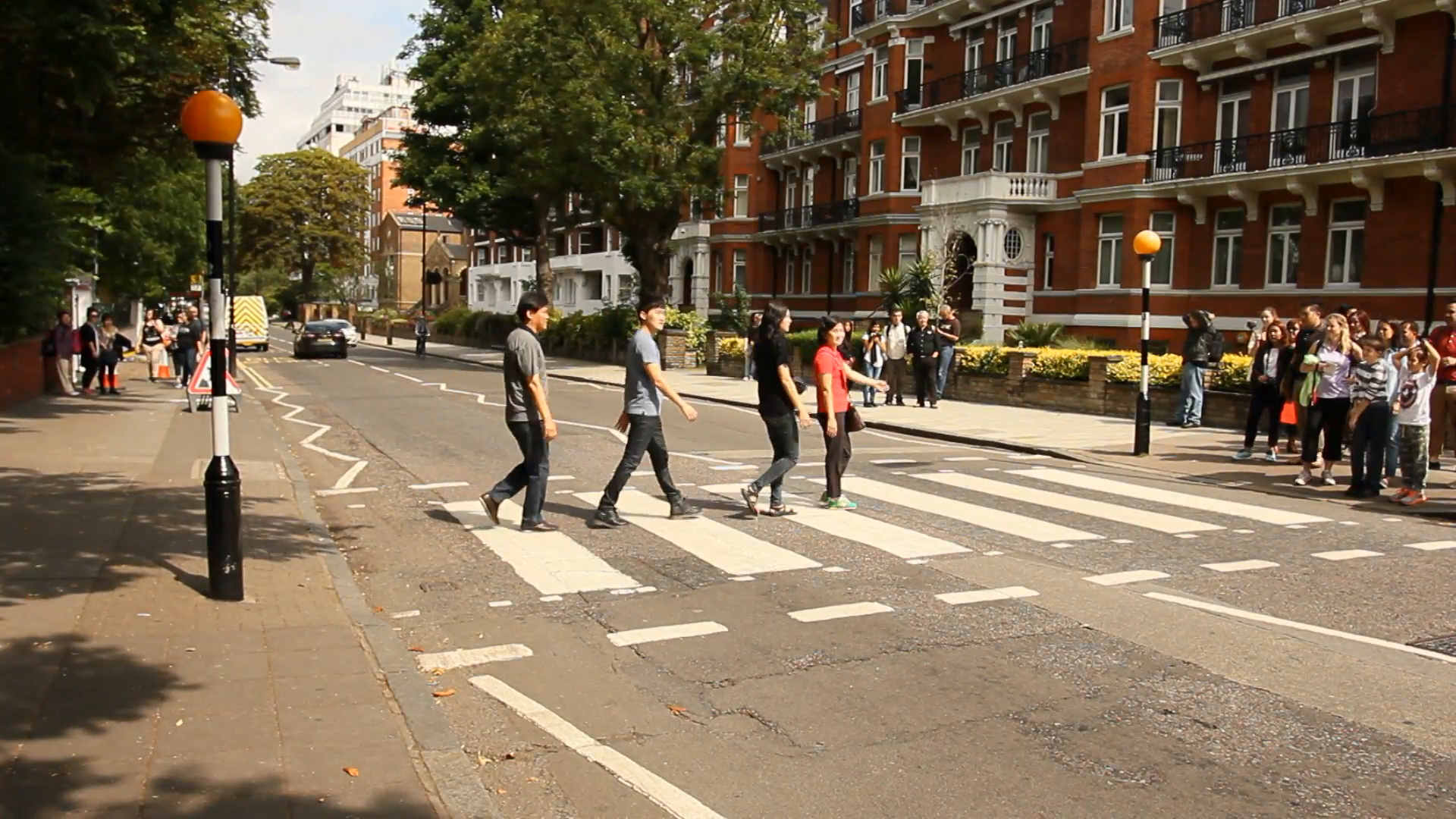 People crossing the street in front of Abbey Road studios, London ...