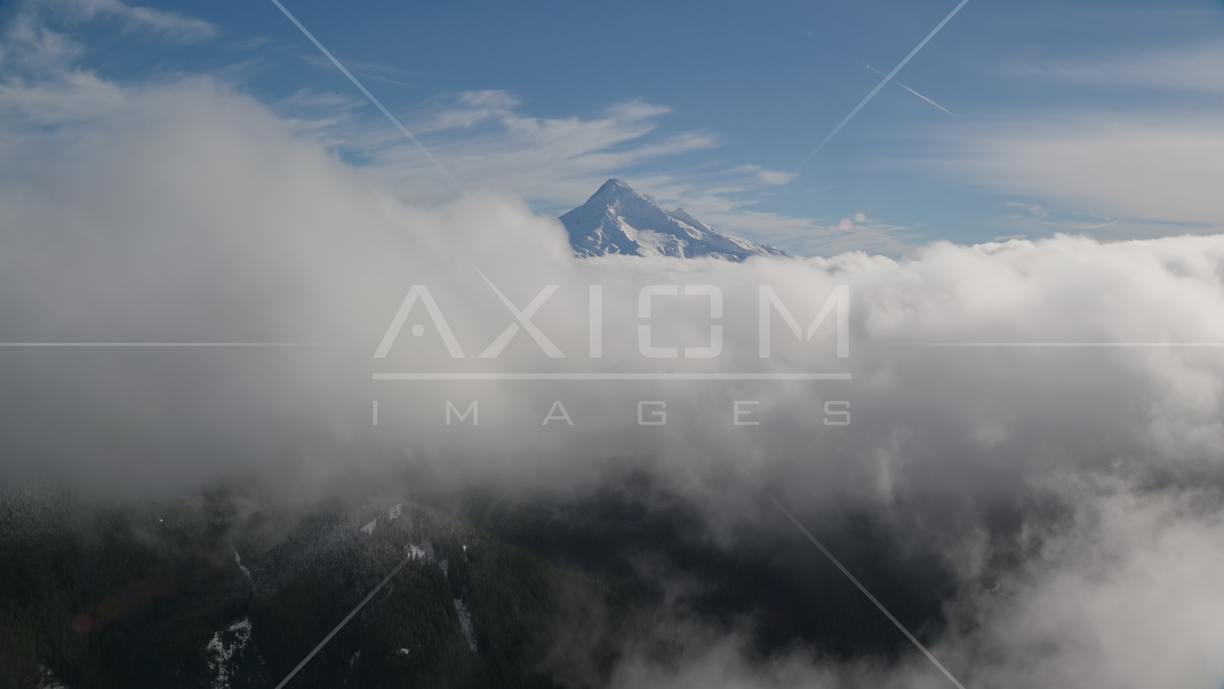 Snowy Mount Hood, visible above a layer of thick clouds, Cascade ...