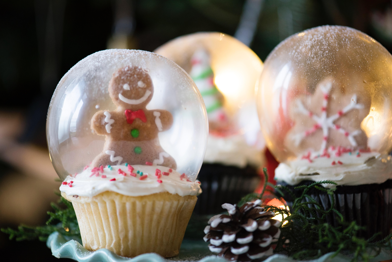 Three christmas-themed glass snow globes photo