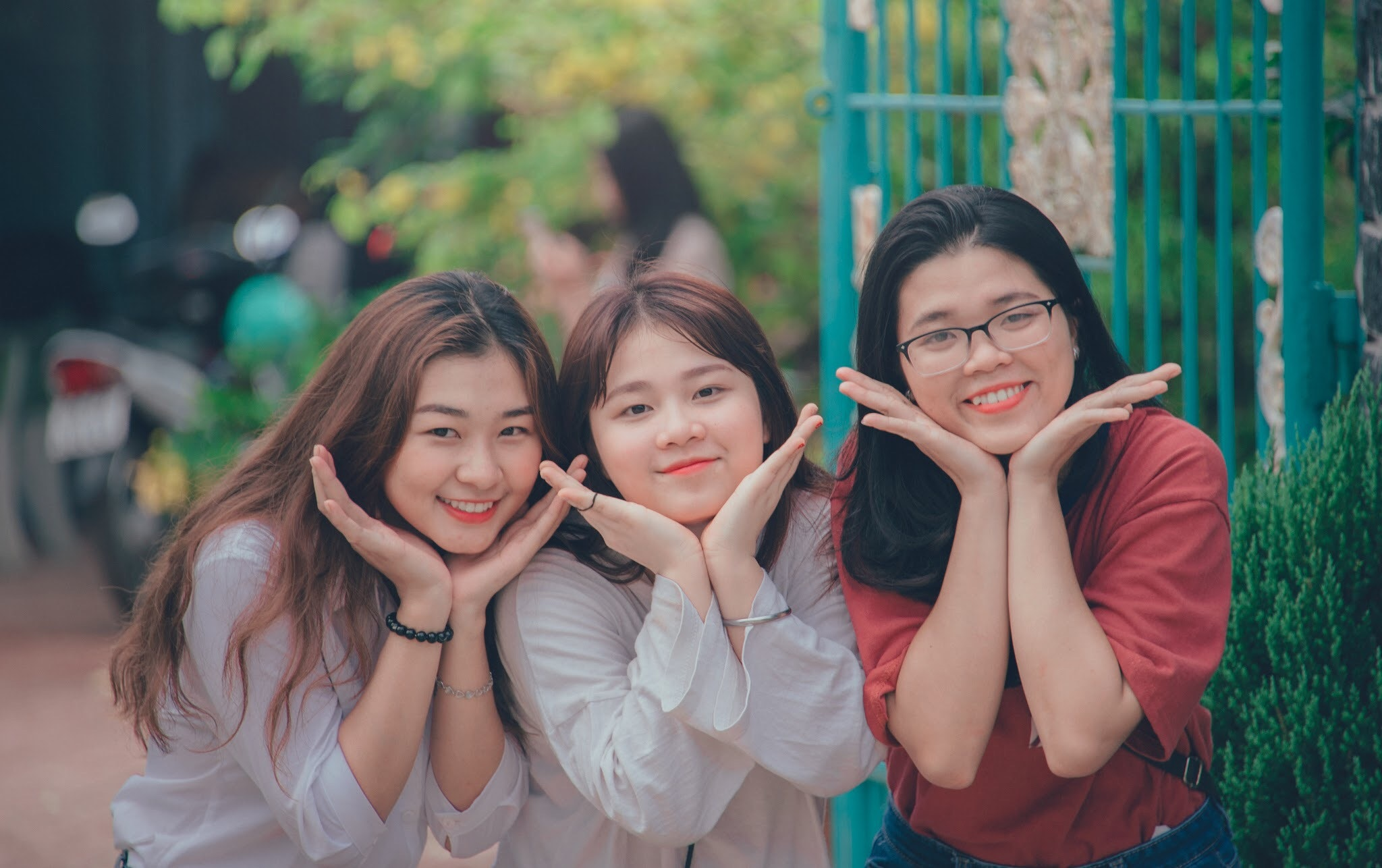 Three girl's wearing white and red dress shirts photo