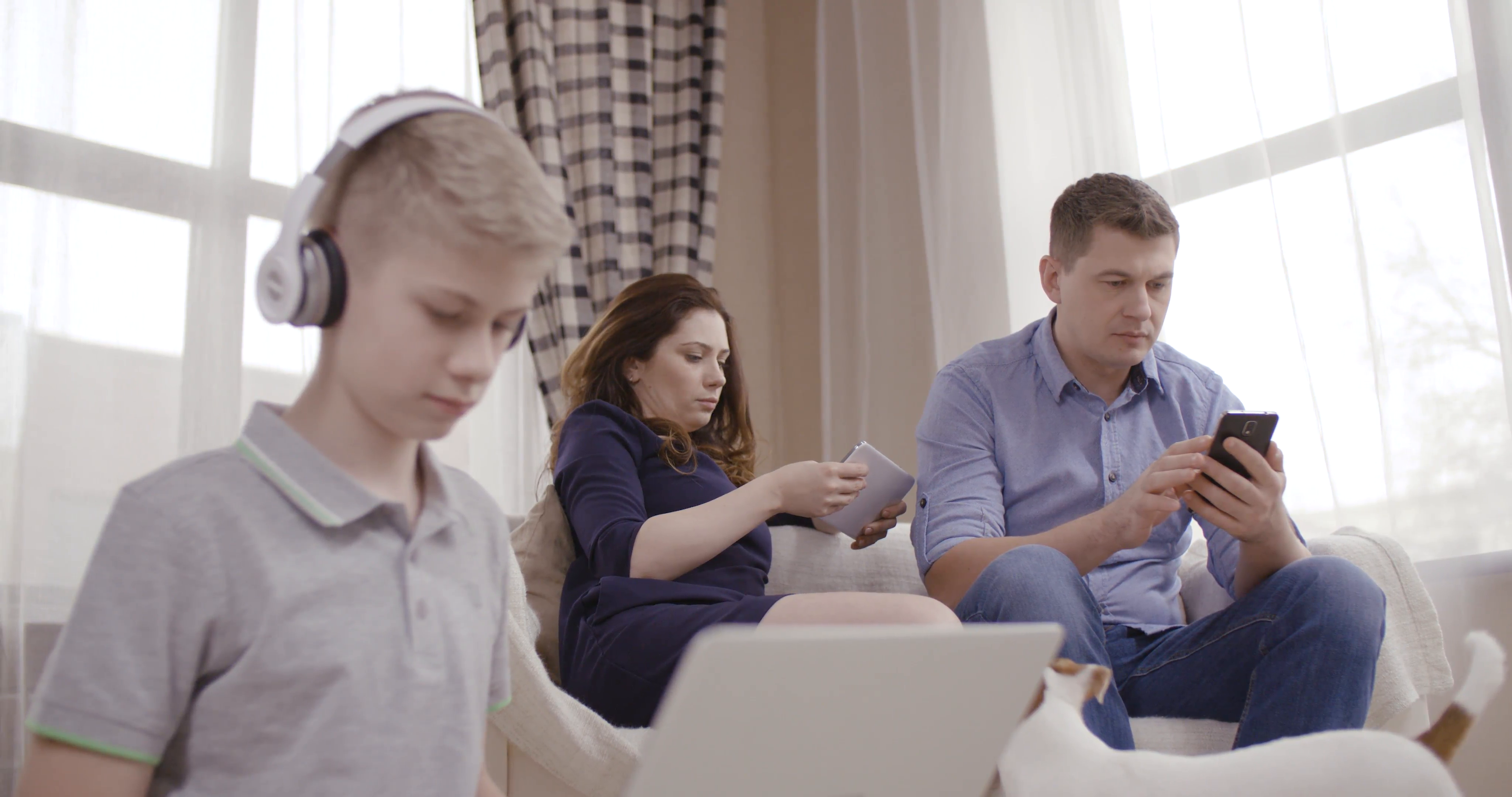 Family of three people uses gadgets and does not communicate ...