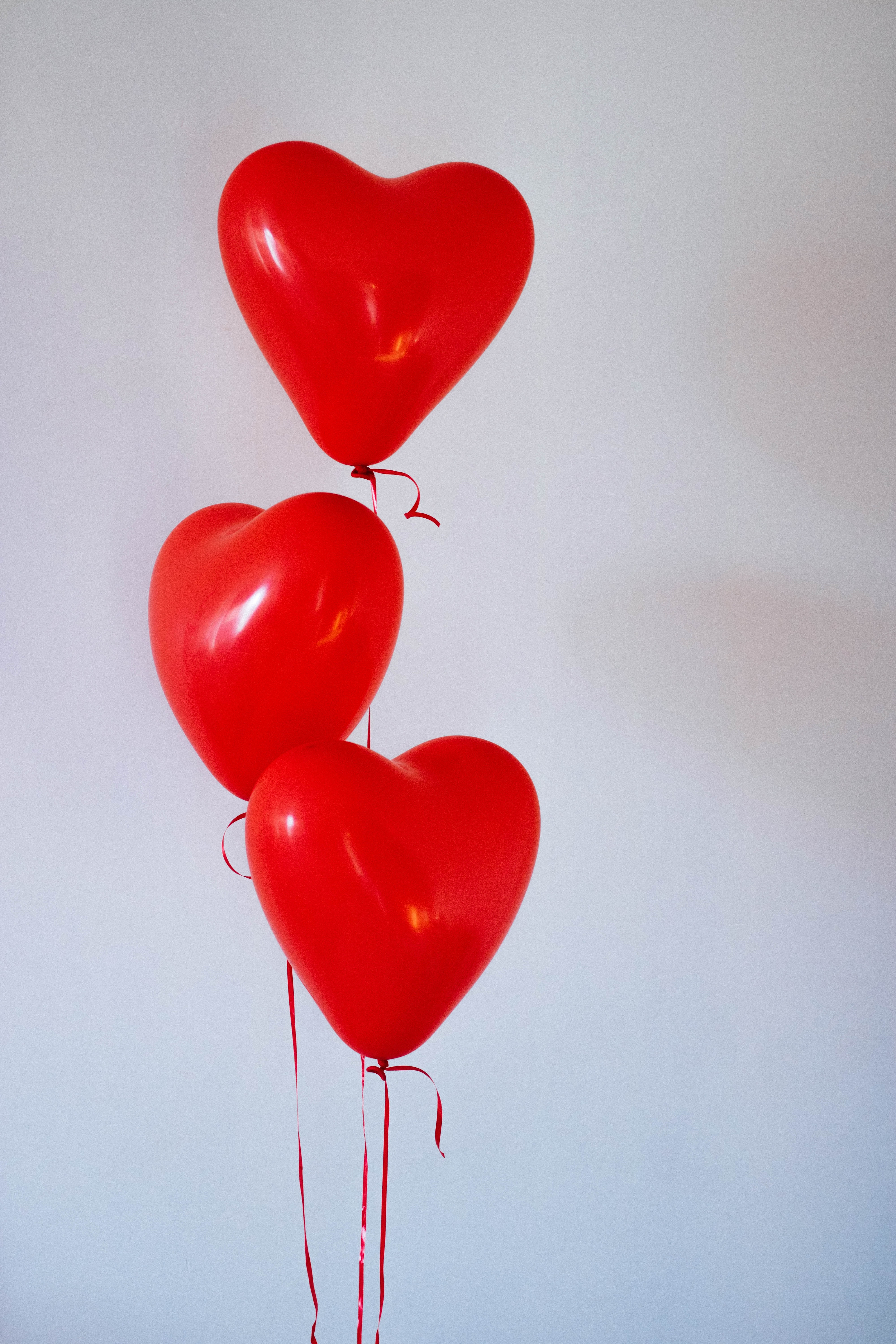 Three red heart balloons photo