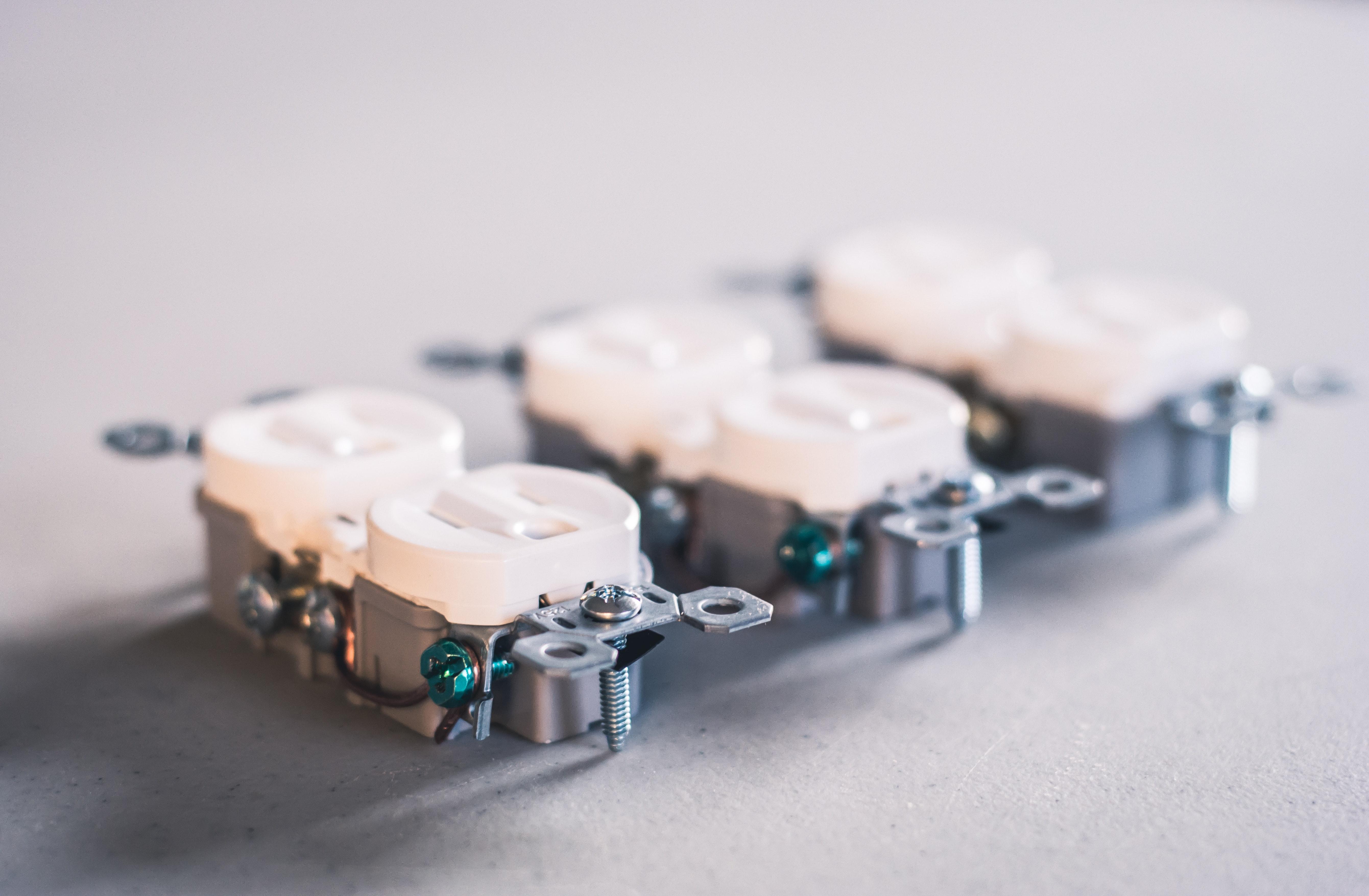 Three white wall sockets photo