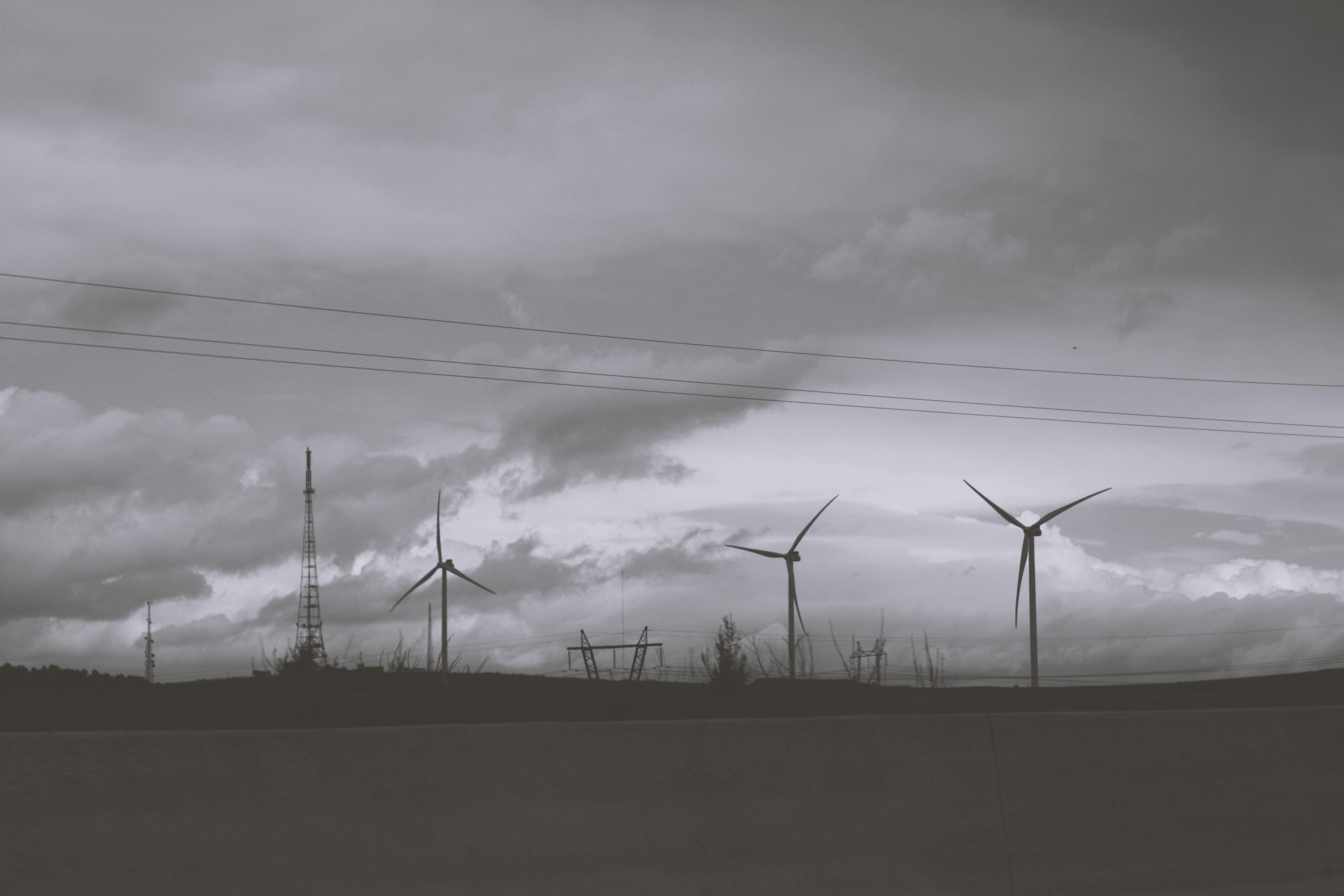 Three wind mills under cloudy sky photo