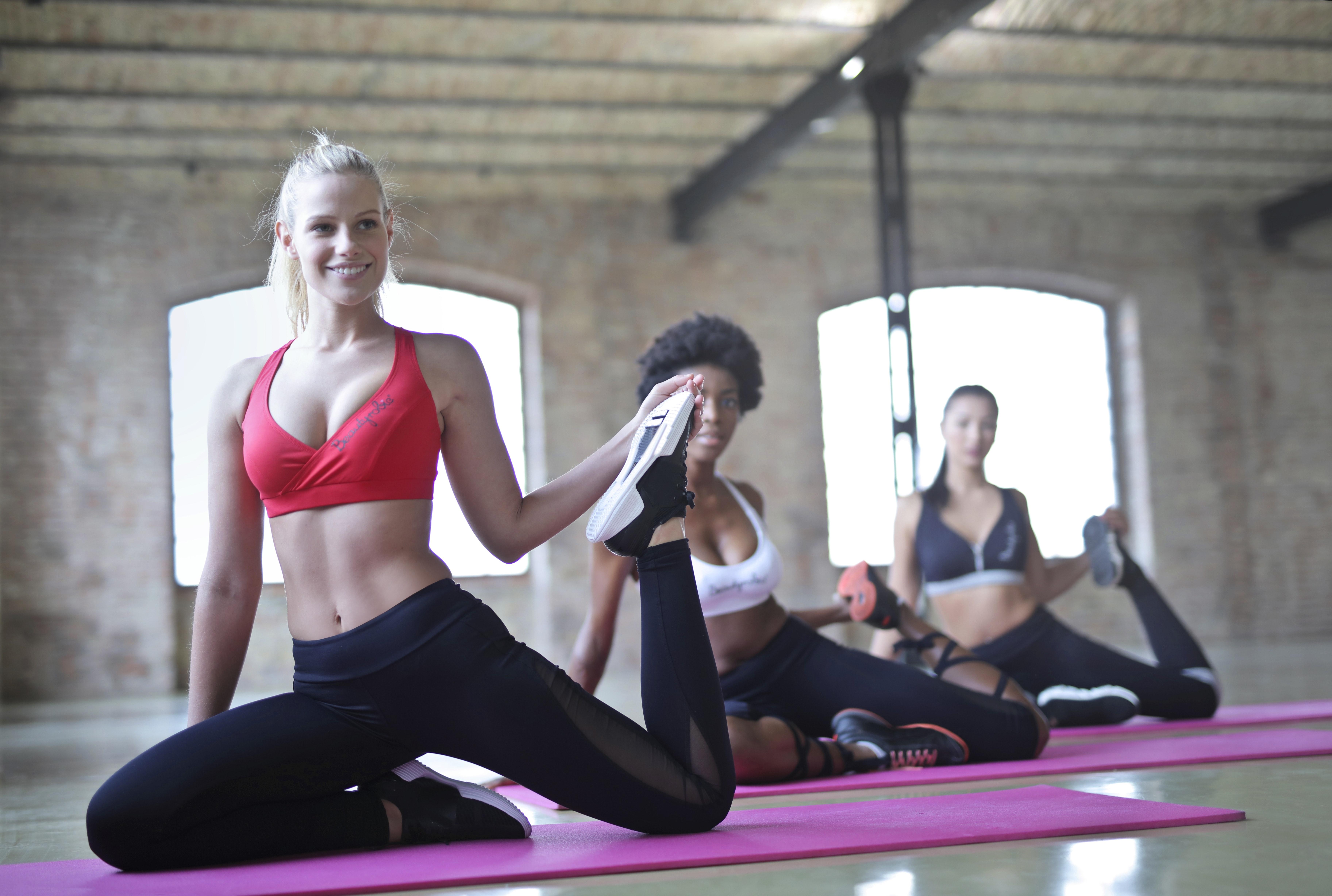 Three women doing yoga photo