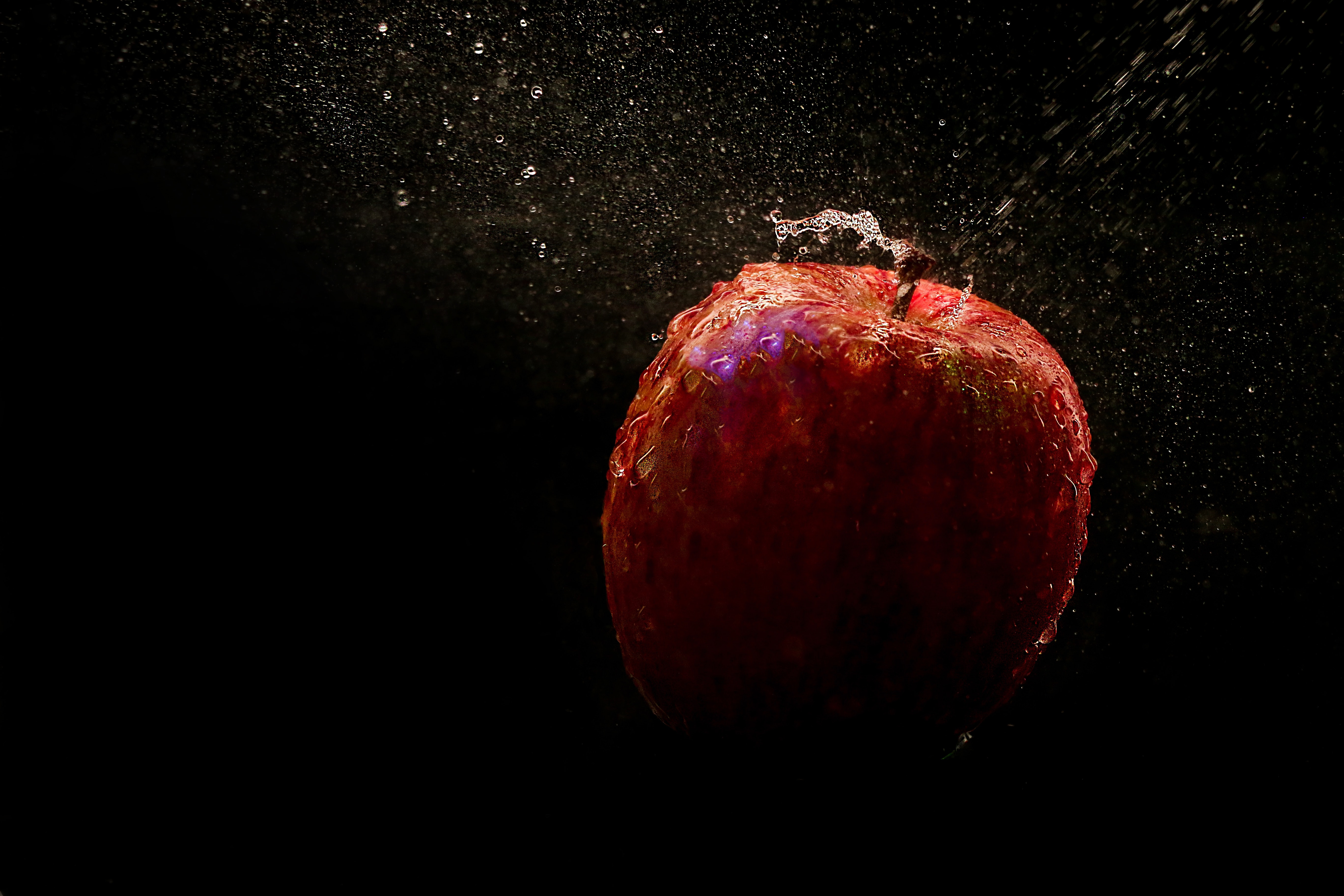 Time lapse photography of falling red apple