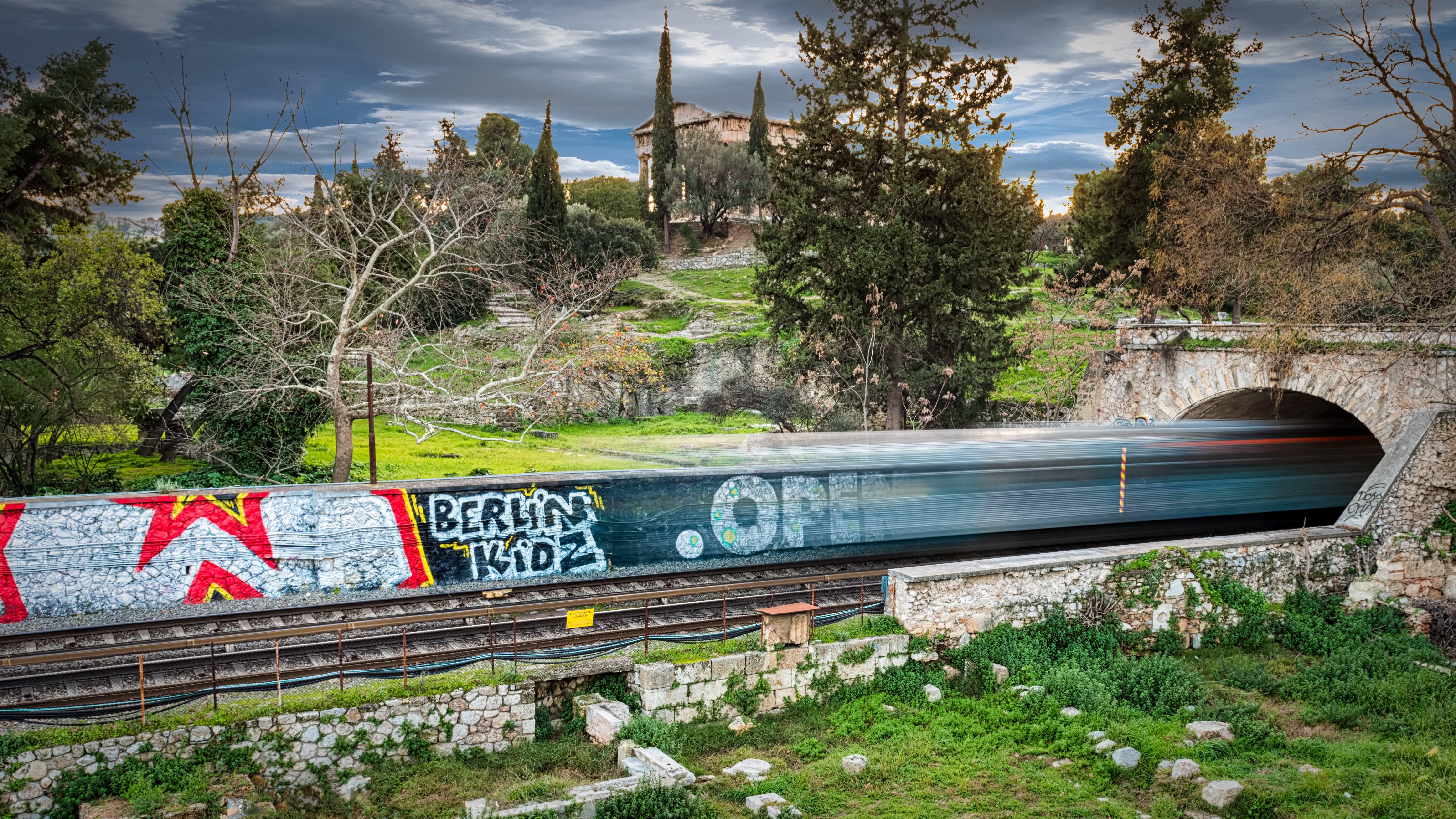 free photo time lapse photography of train passing through bridge