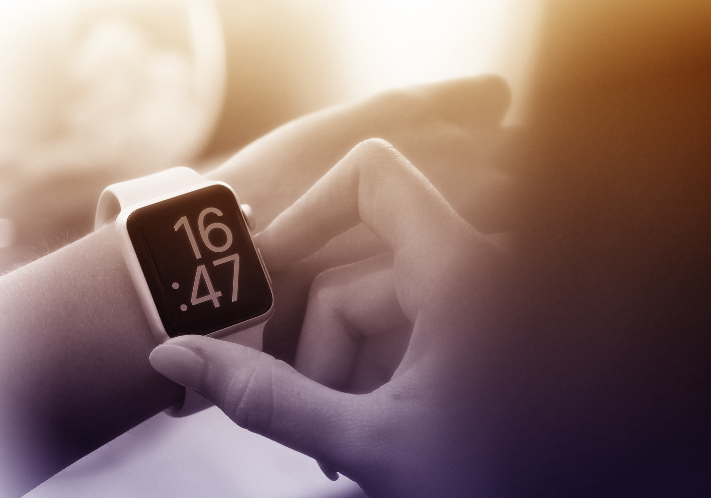 Time to go - a woman checks the time on smartwatch photo